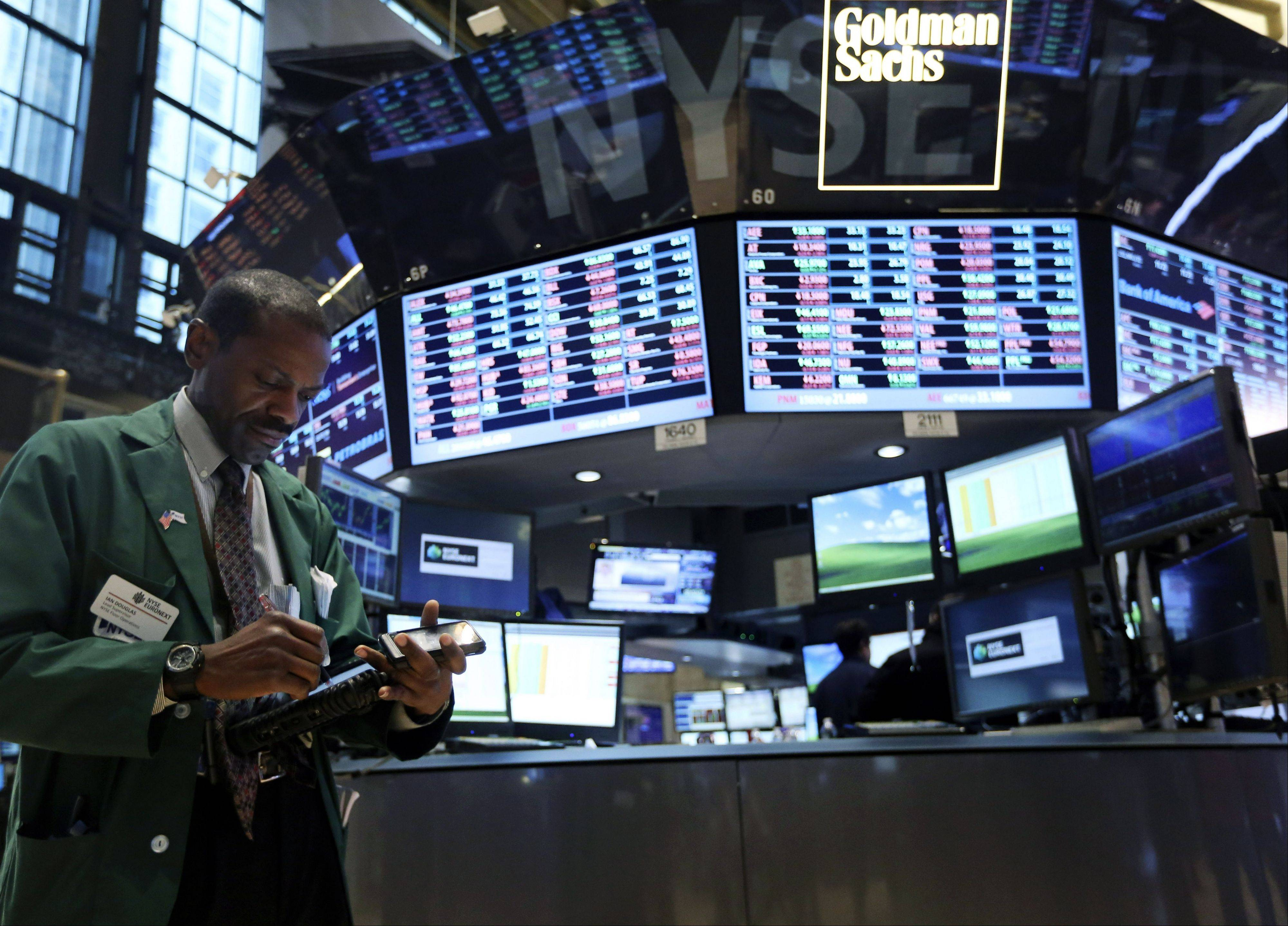 A trader works Thursday on the floor of the New York Stock Exchange.