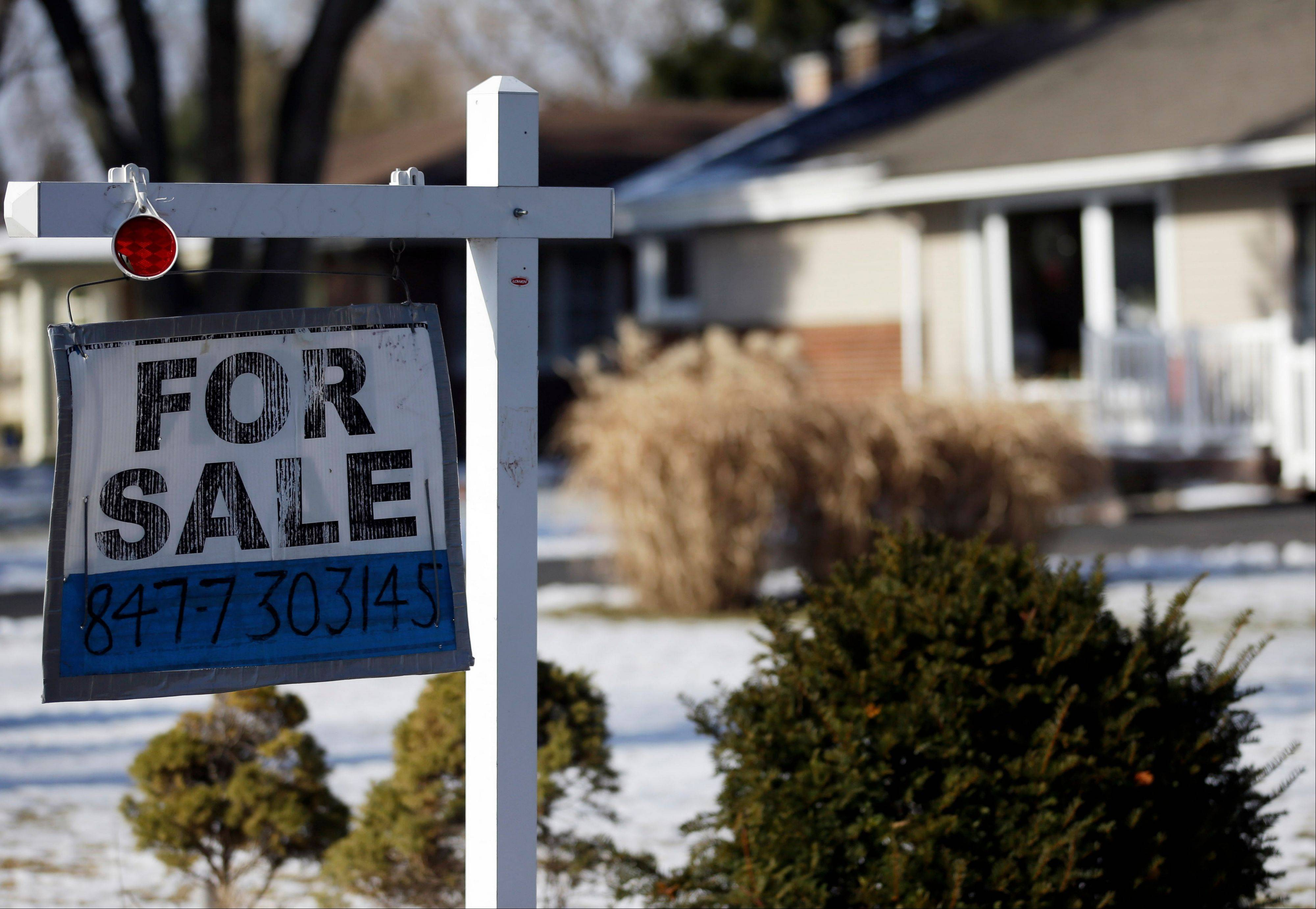 "A ""for sale"" sign outside a home in Glenview, Ill. Five of the biggest U.S. banks have cut struggling homeowners' mortgage balances by $19 billion, part of a total $45.8 billion in relief provided under a landmark settlement over foreclosure abuses."