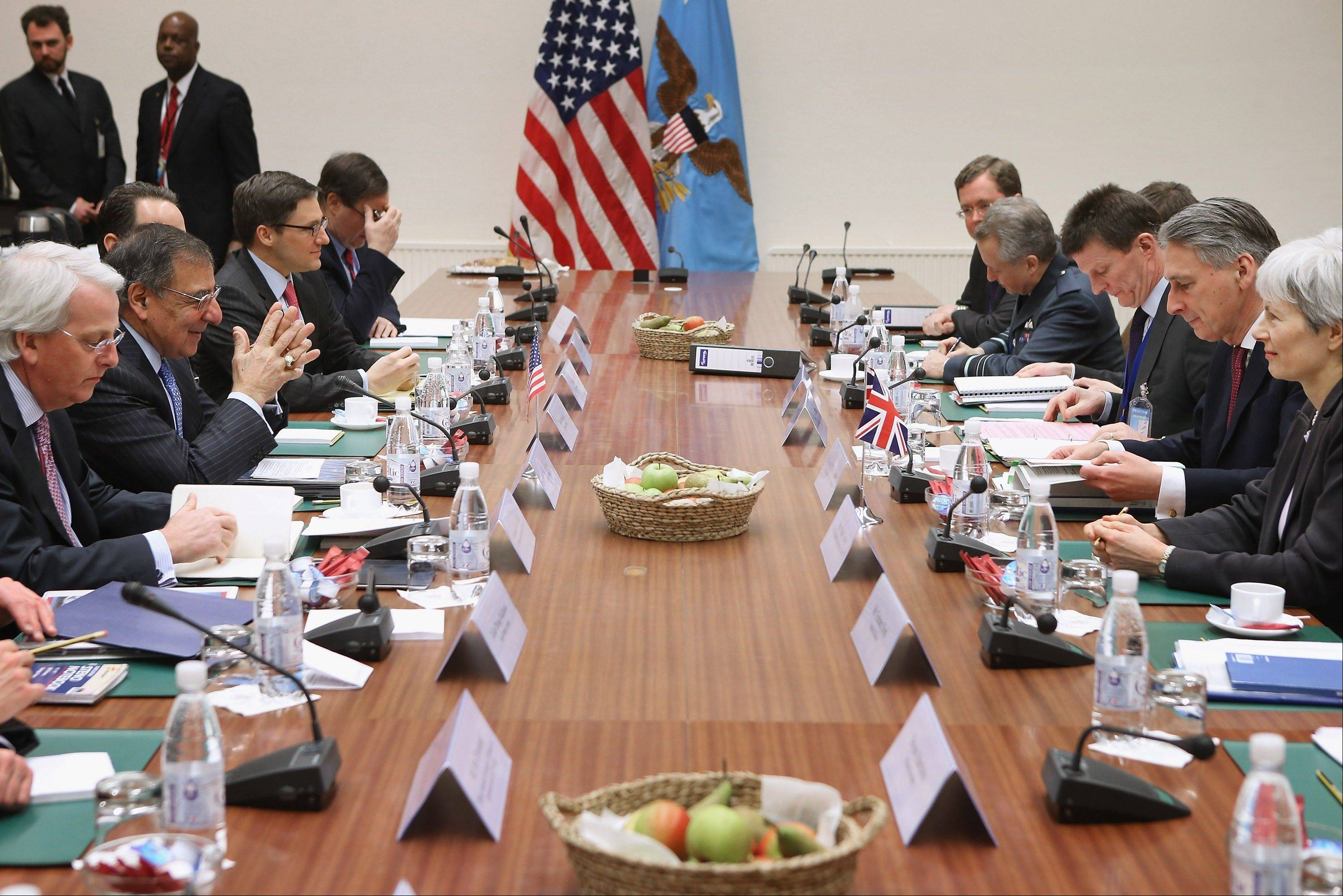 Defense Secretary Leon Panetta and British Defense Secretary Philip Hammond lead their delegations Friday during a bilateral meeting at the North Atlantic Treaty Organization Defense Ministers Meeting at NATO headquarters in Brussels, Belgium.