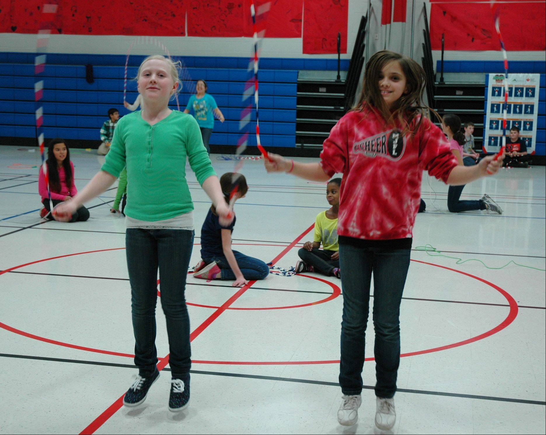 Fremont Intermediary School students Lucy Gustafson, left, and Kelsey Hassan were among those who participated in the school's Jump Rope for Heart fundraiser. The event raised $20,514 for the American Heart Association.