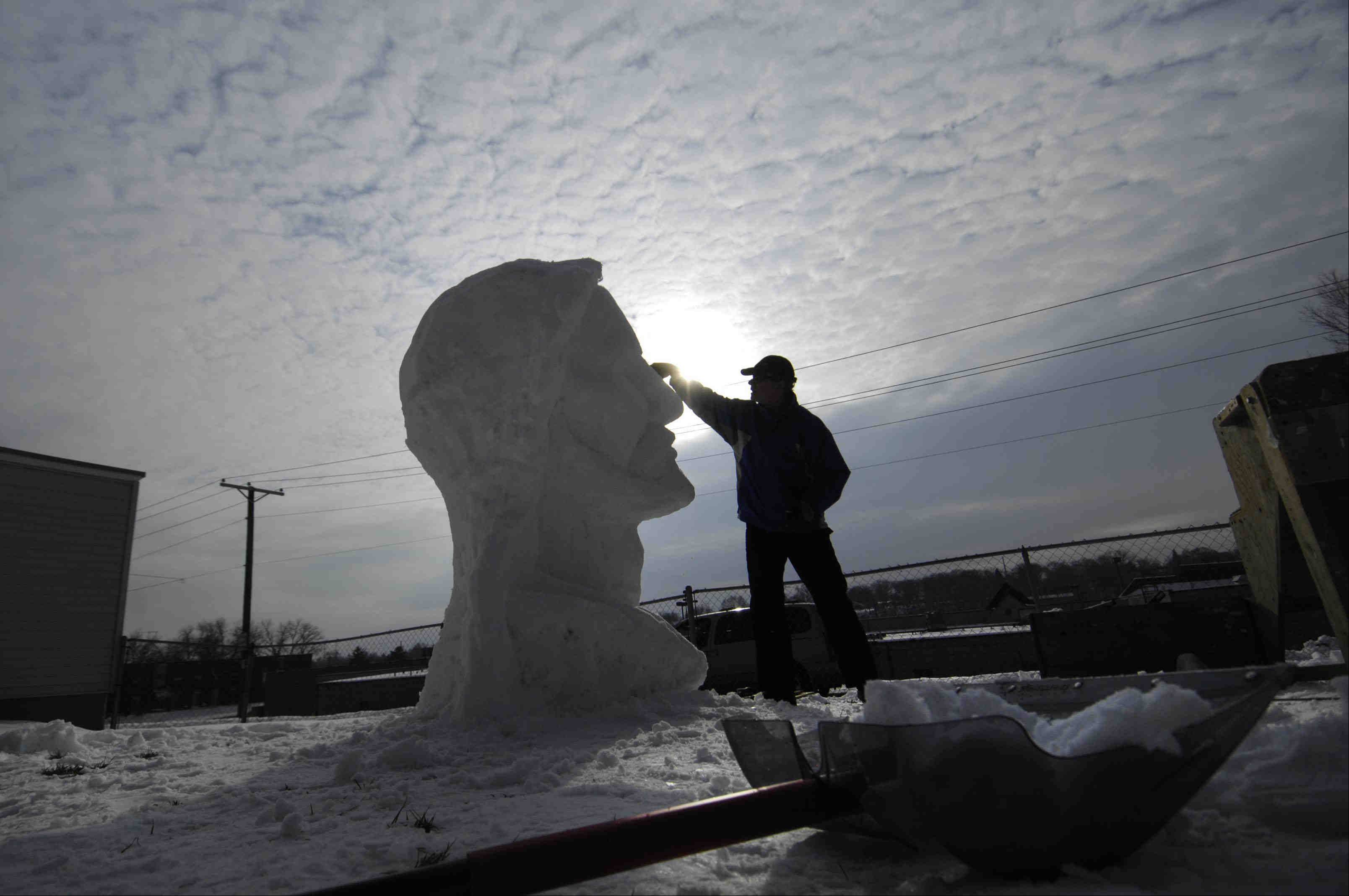 Fran Volz has been creating snow sculptures in his yard for 25 years. This year, he moved from Arlington Heights to Elgin and created a neighborhood buzz with his first sculpture, a 7�-foot-tall Jesus. He spent the first day making blocks of snow and stacking them. Then the next two days were spent using his homemade tools to carve and sculpt the figure.