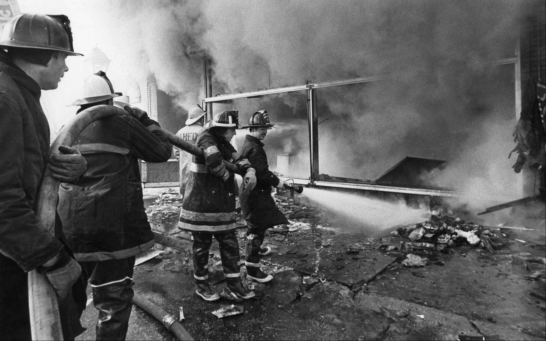 Palatine firefighters work at the Feb. 23, 1973 scene of the Ben Franklin store fire that killed three volunteer firefighters.