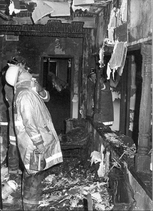 Investigators examine the remnants of the Ben Franklin store in Palatine after a fire killed three volunteer firefighters on Feb. 23, 1973.