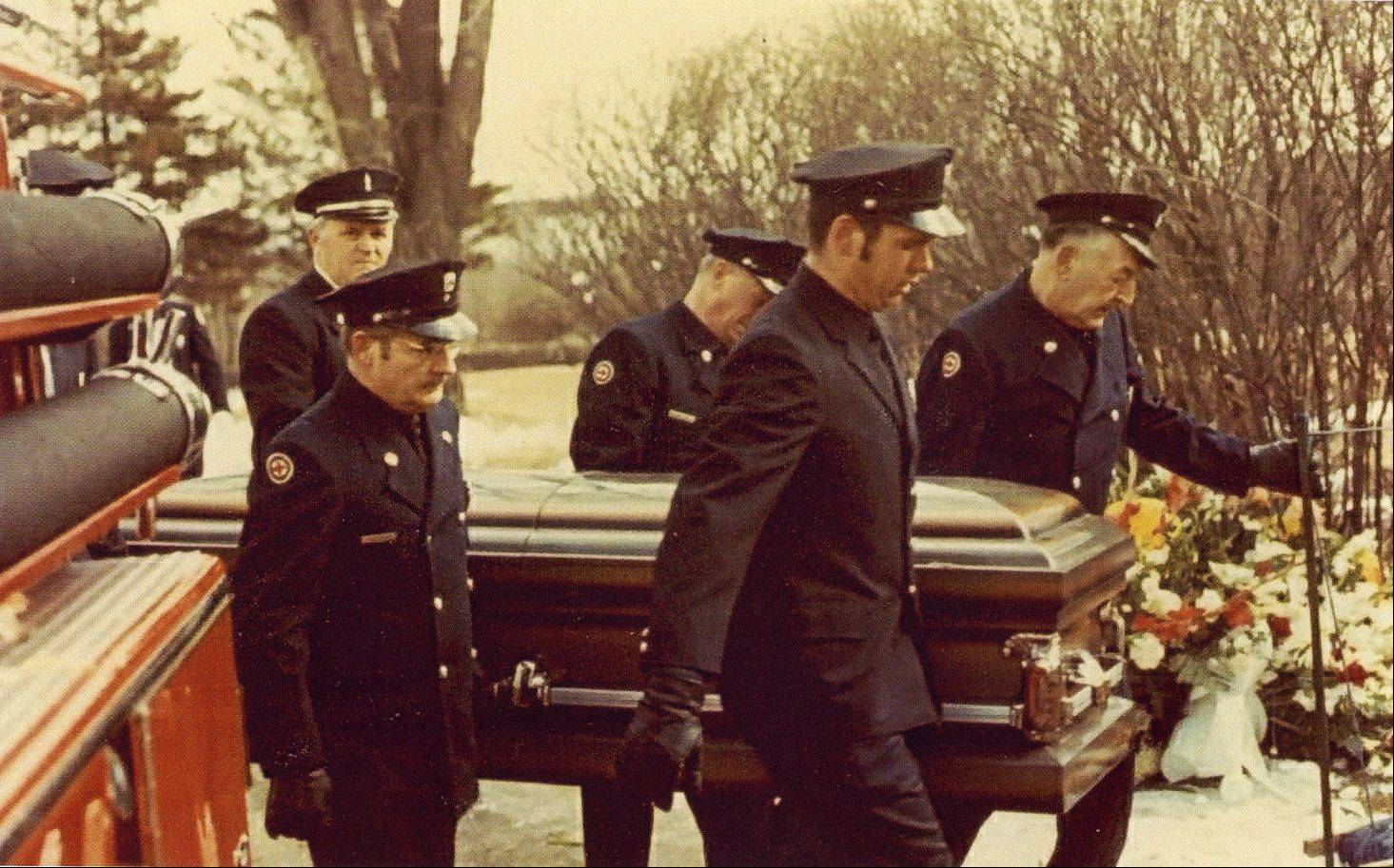 Palatine firefighters carry the casket of one of their three fallen brothers who died Feb. 23, 1973, fighting the Ben Franklin store fire.
