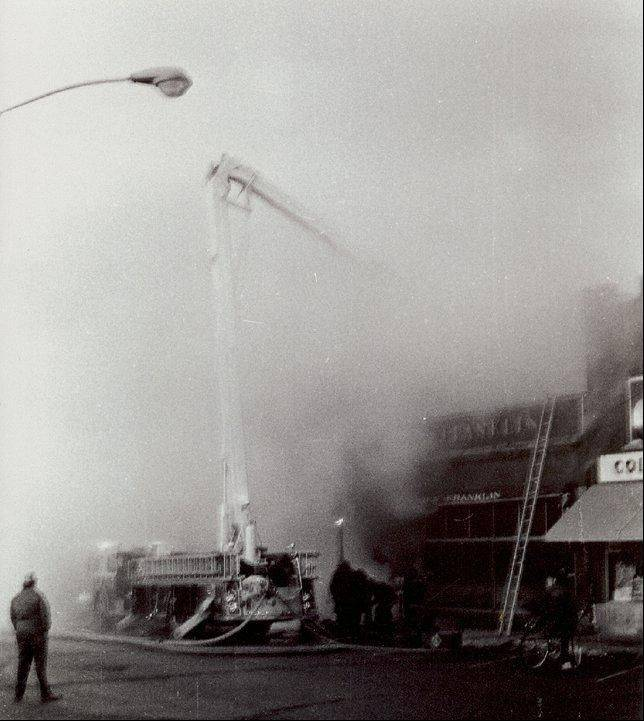 Firefighters work to extinguish the blaze at the Ben Franklin store in Palatine on Feb. 23, 1973. Three volunteer firefighters were killed.