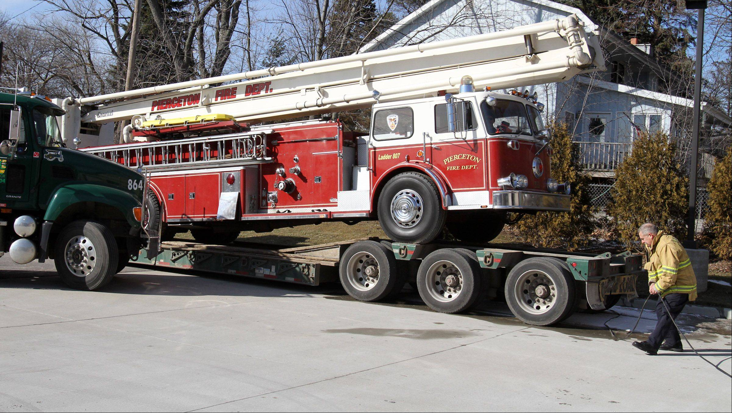 Palatine Fire Captain Jeff Bober on Wednesday helps unload the same Snorkel fire truck that was used in the Ben Franklin store fire Feb. 23, 1973. The truck was delivered from an Indiana fire department to be part of this weekend's ceremony.