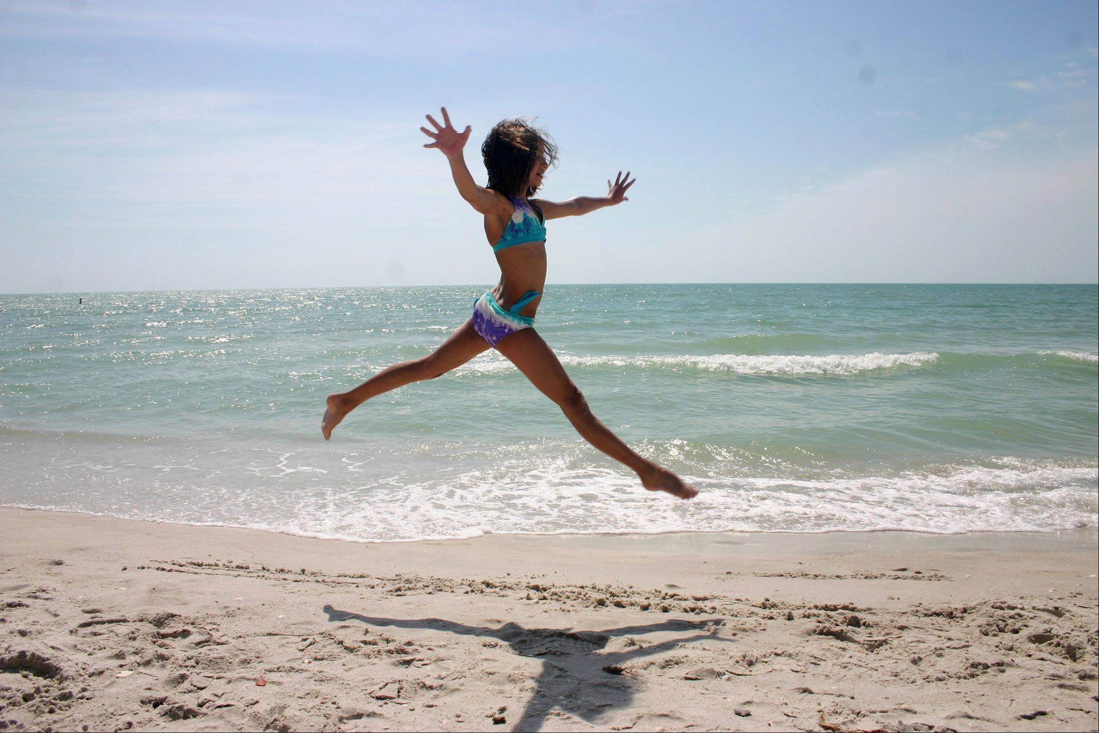 A girl leaps on the beach near Bonita Springs, Florida on March 25, 2010.