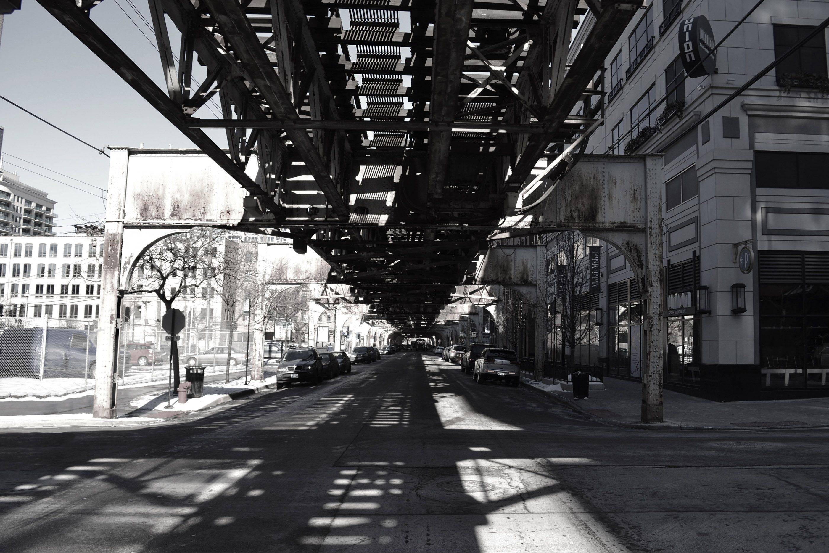 I took this photograph while in downtown Chicago this January. I am an AP Studio Art student at Naperville North High School, and thought the underside of this bridge conveyed a very striking yet beautiful image. The interesting lines and architecture make it a very dramatic black and white image.