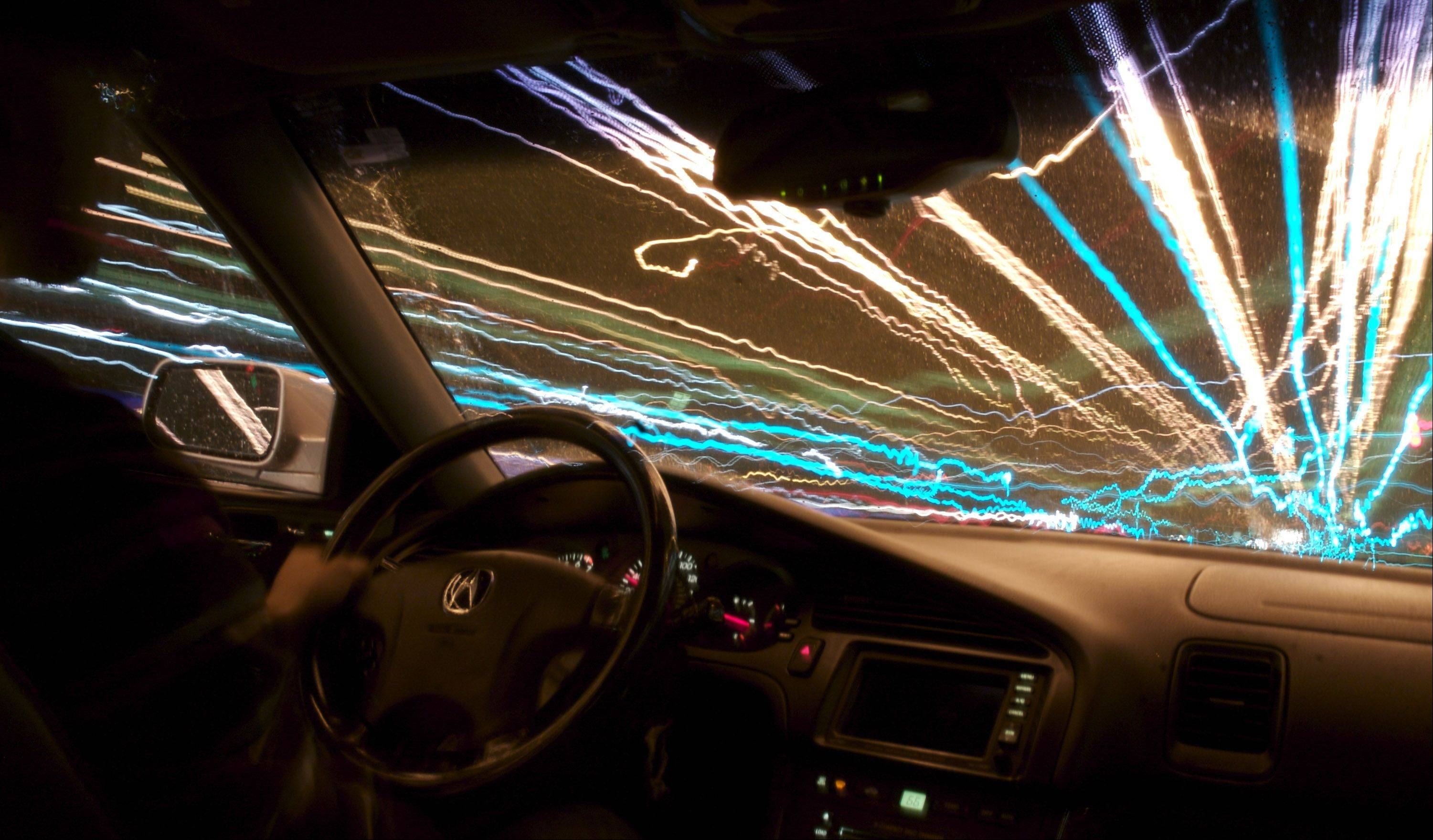 My submission is of a long exposure taken in my car while I was driving in Naperville. The photograph was taken with a Sigma f3.5 18-200 lens mounted to a Canon 30D with a cable shutter release.