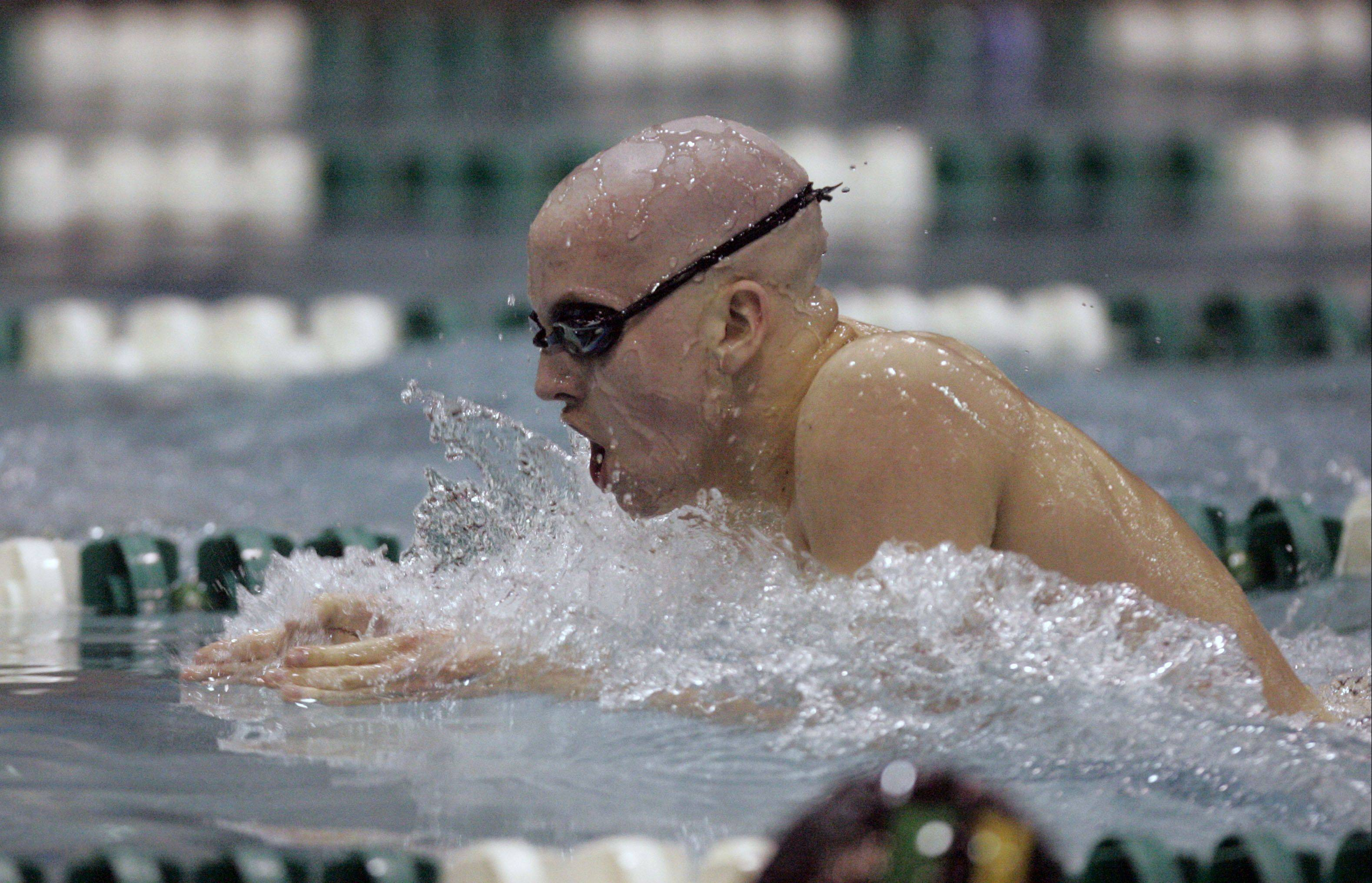 St. Charles East's Will Shanel swims the 200-yard medley.