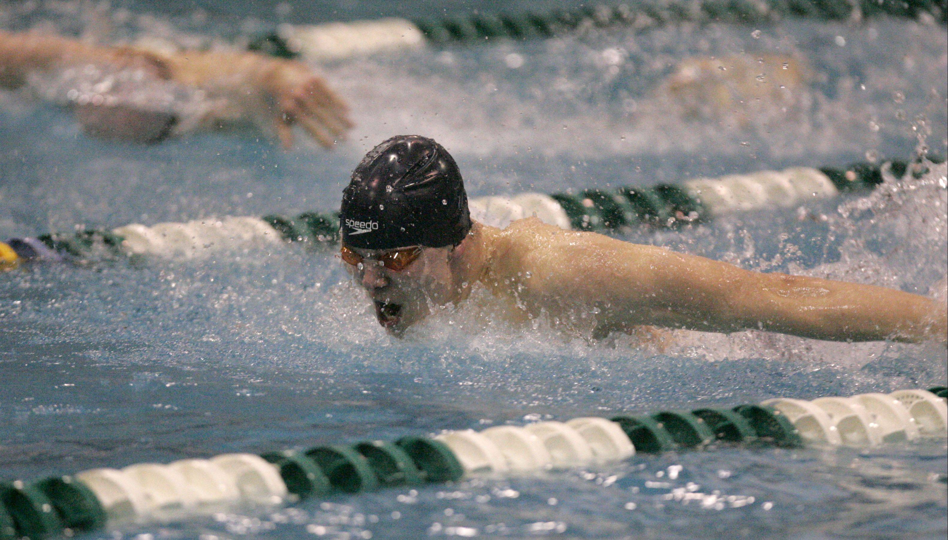 Marmion's Robert Ramoska swims the 100-yard butterfly.