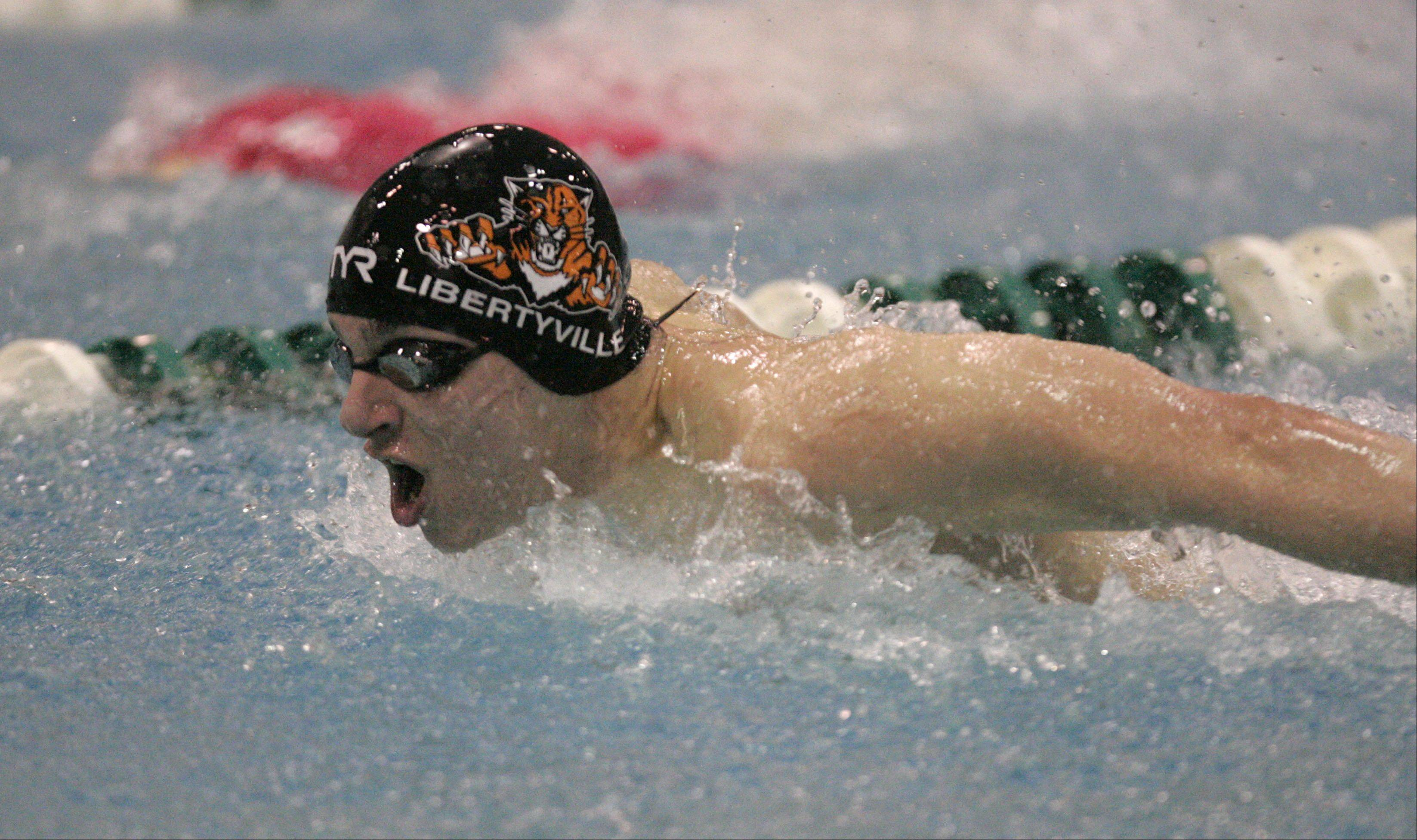 Brian Hill/bhill@dailyherald.comMatt Harrington of Libertyville competes in the 100-yard butterfly during the IHSA State Swimming Prelims at New Trier High School in Winnetka Friday.