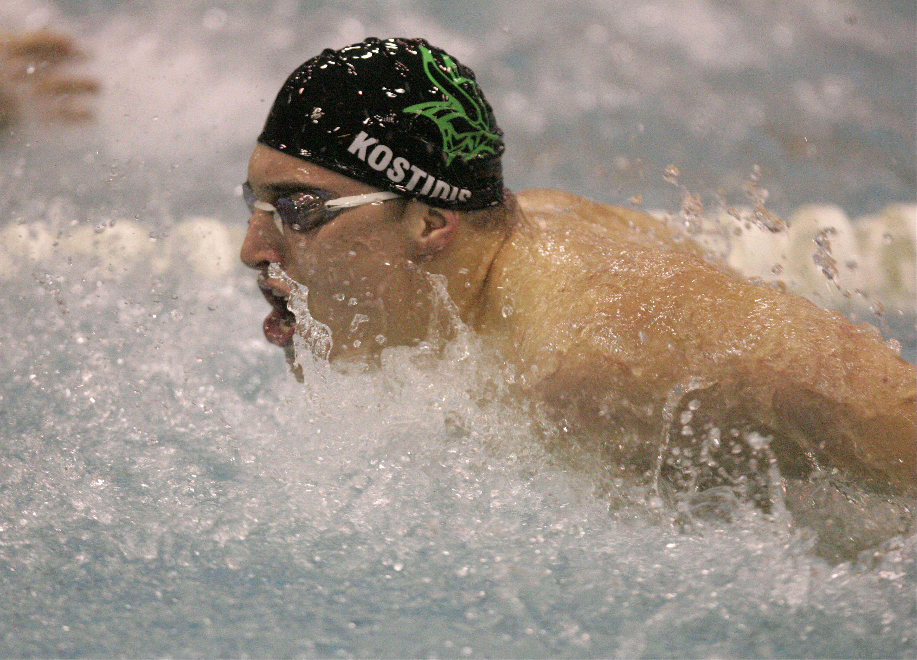 Dennis Kostidis of Fremd competes in the 100-yard butterfly during the boys swimming state meet prelimiinaries at New Trier High School on Friday.