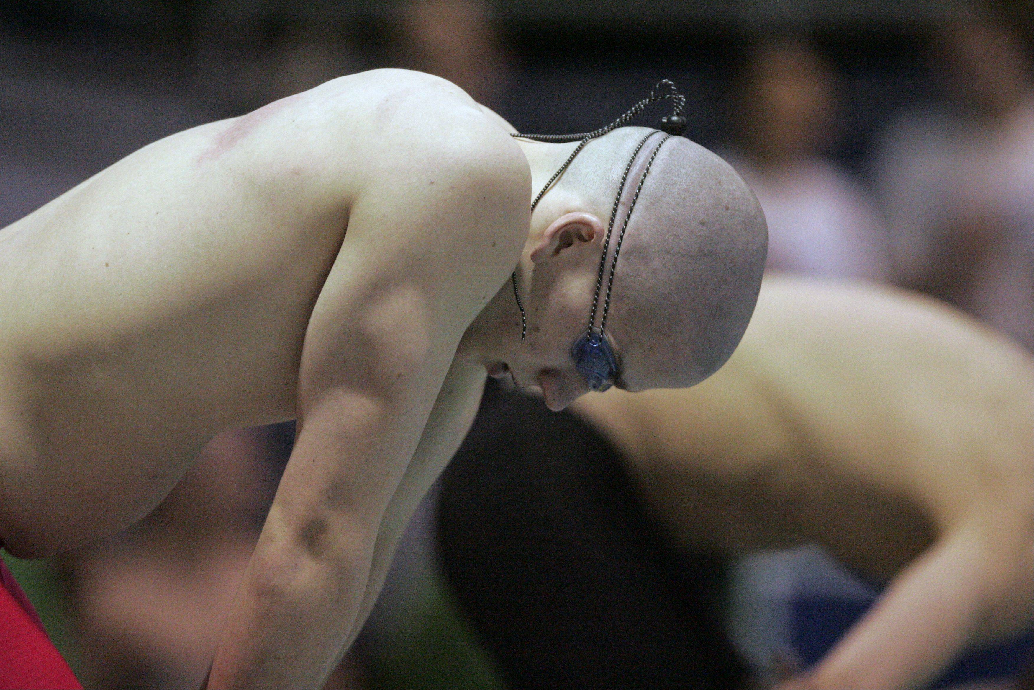Brian Hill/bhill@dailyherald.comJonathon Burke of Conant prepares to compete in the 500-yard freestyle during the boys swimming state meet prelimiinaries at New Trier High School on Friday.