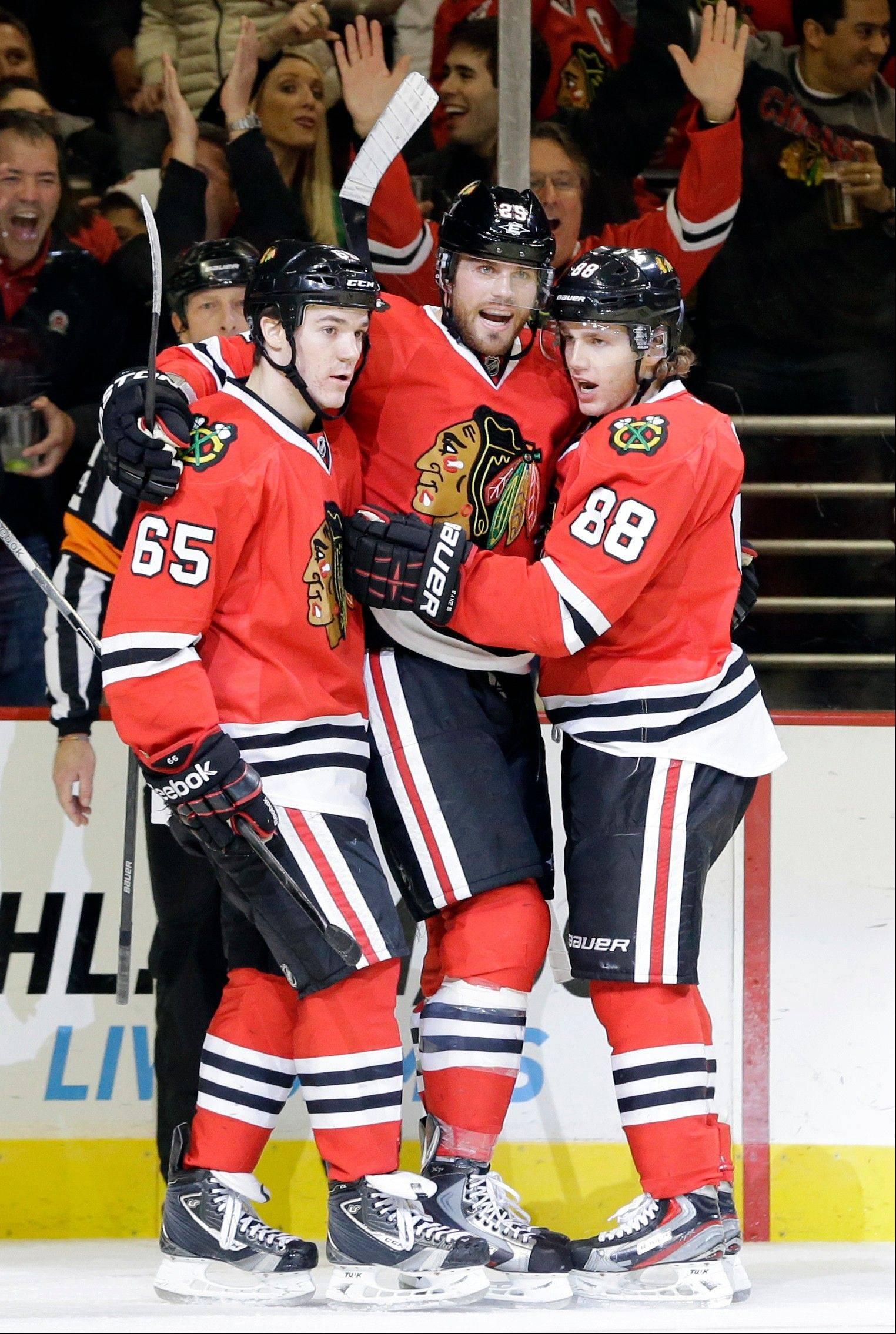 Chicago Blackhawks' Viktor Stalberg, center, celebrates with Andrew Shaw, left, and Patrick Kane after scoring a goal during the second period of an NHL hockey game against the San Jose Sharks in Chicago, Friday, Feb. 22, 2013.