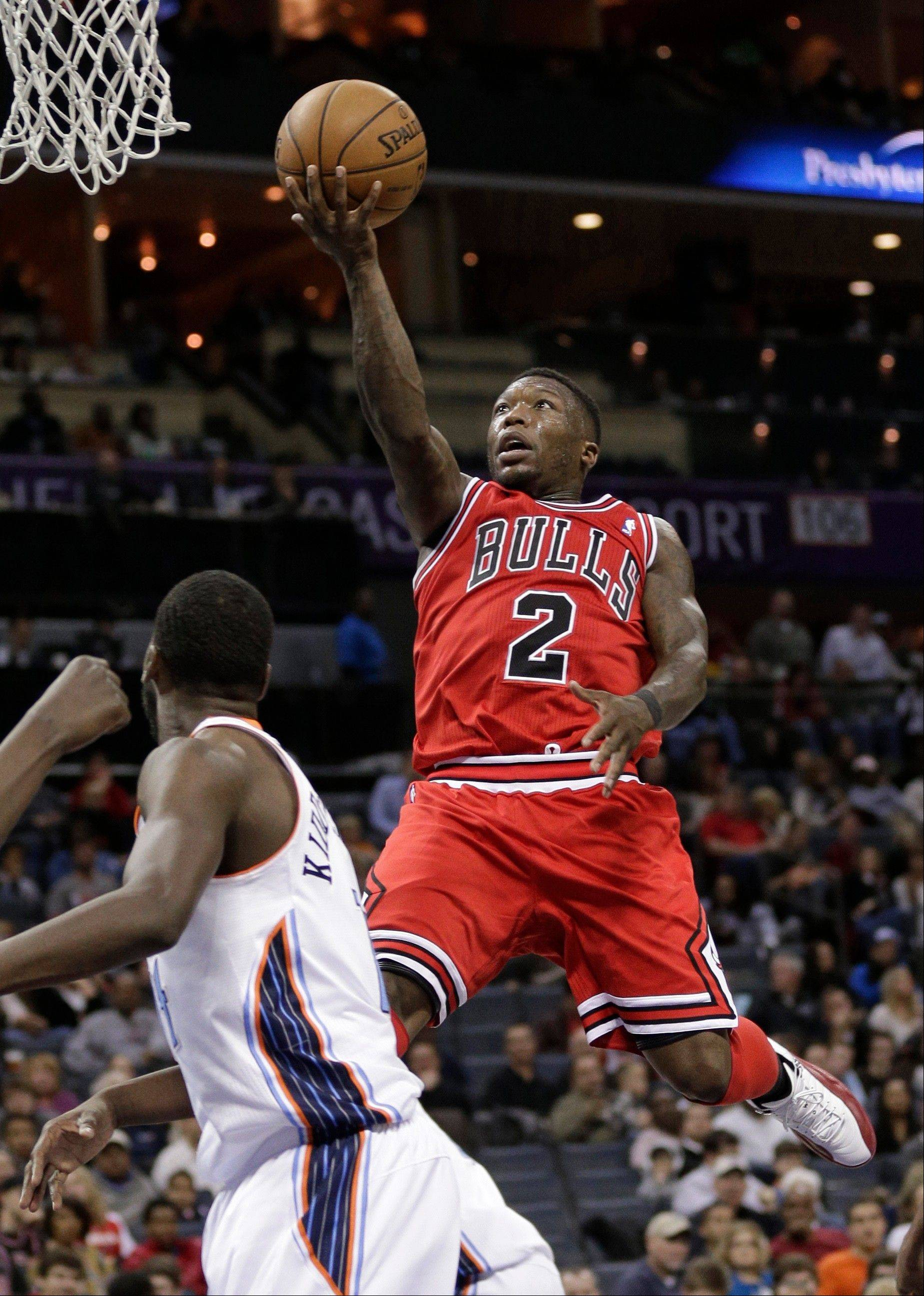 Chicago Bulls' Nate Robinson (2) drives to the basket against Charlotte Bobcats' Michael Kidd-Gilchrist during the second half of an NBA basketball game in Charlotte, N.C., Friday, Feb. 22, 2013. The Bulls won 105-75.
