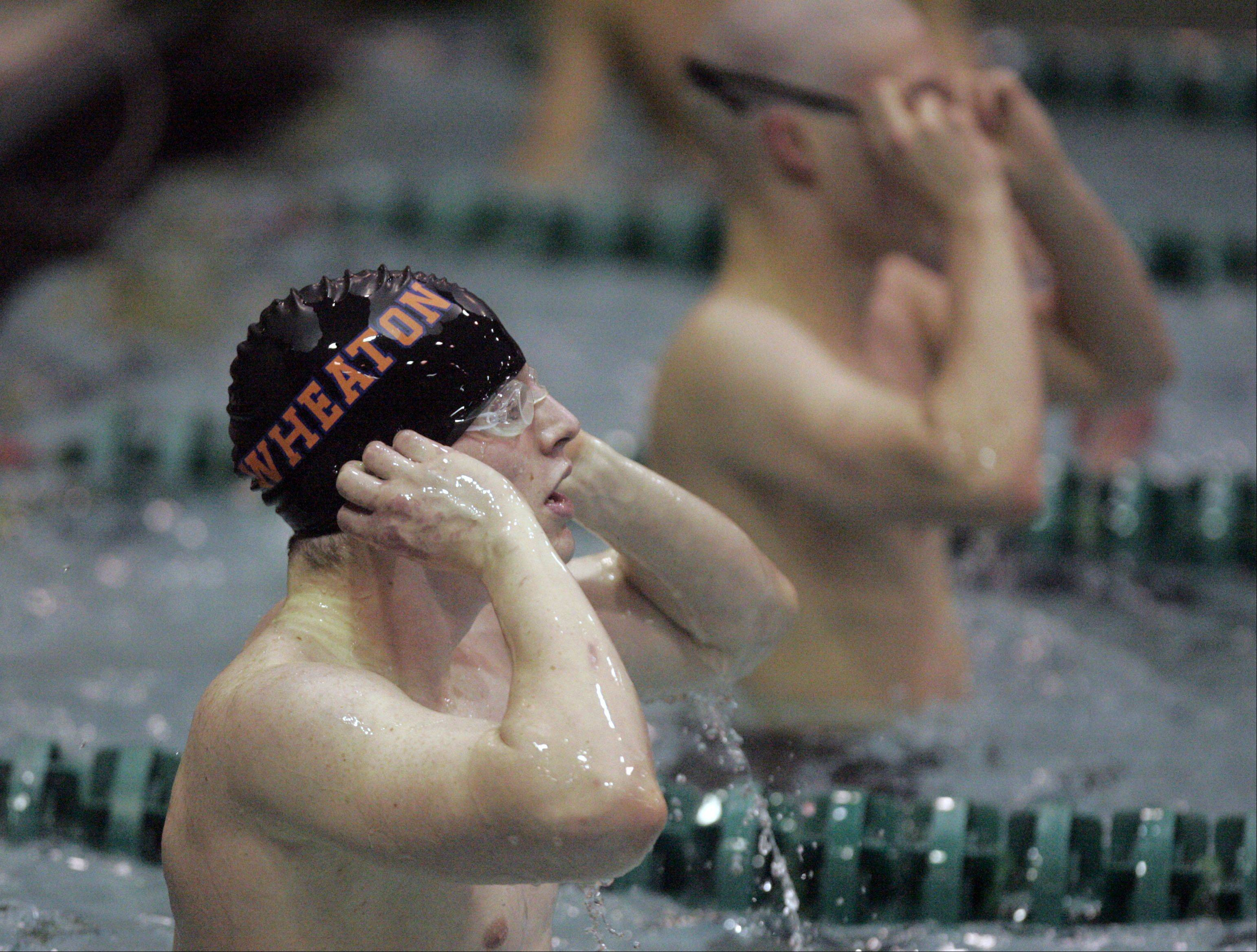 James Hasbrouck of Wheaton North reacts to his time in the 50-yard freestyle during the IHSA State Swimming Prelims at New Trier High School in Winnetka Friday.