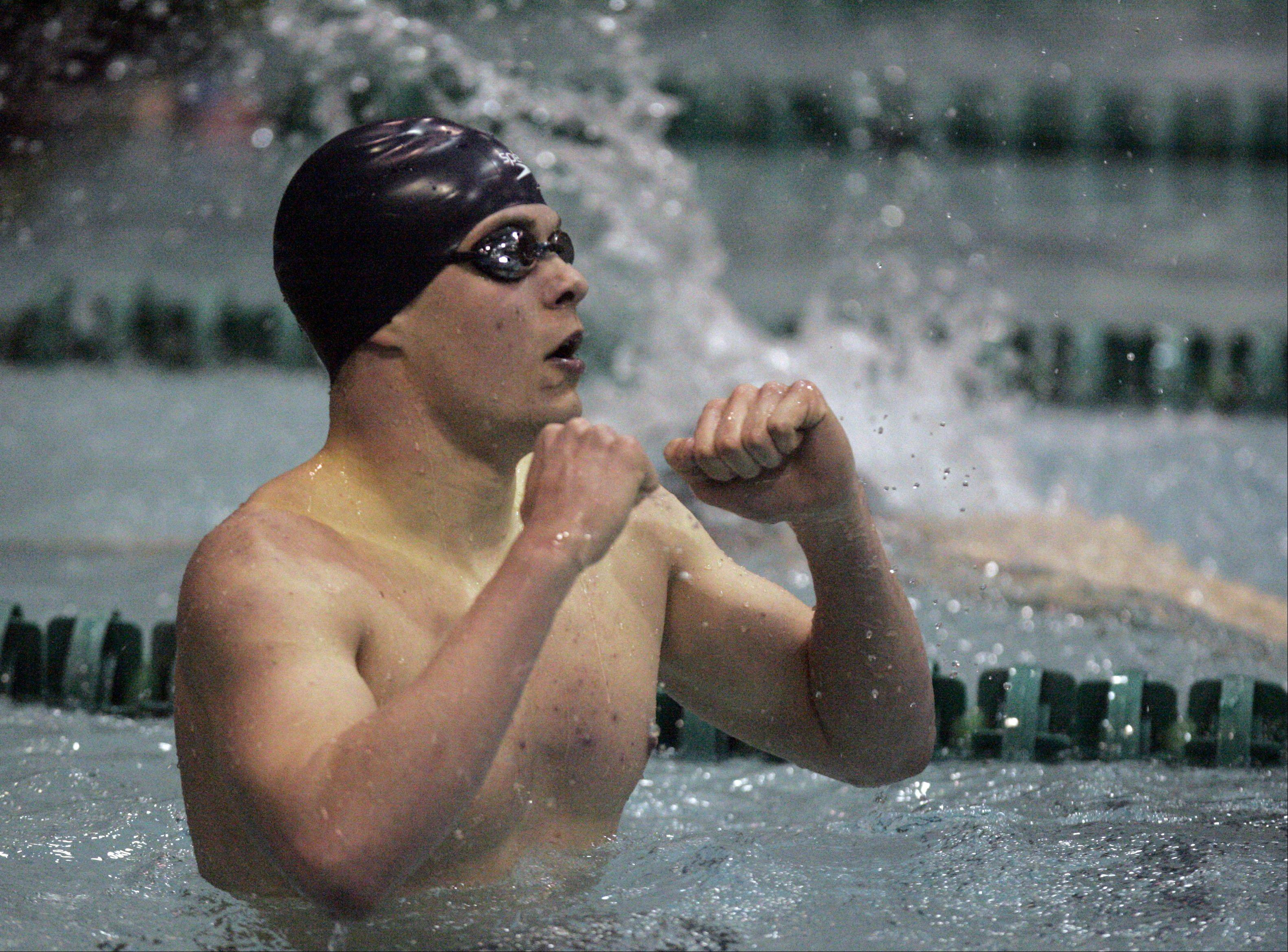 Michael Hamman of Cary-Grove reacts to his time in the 200-yard individual medley during the IHSA state swimming prelims at New Trier High School in Winnetka Friday.
