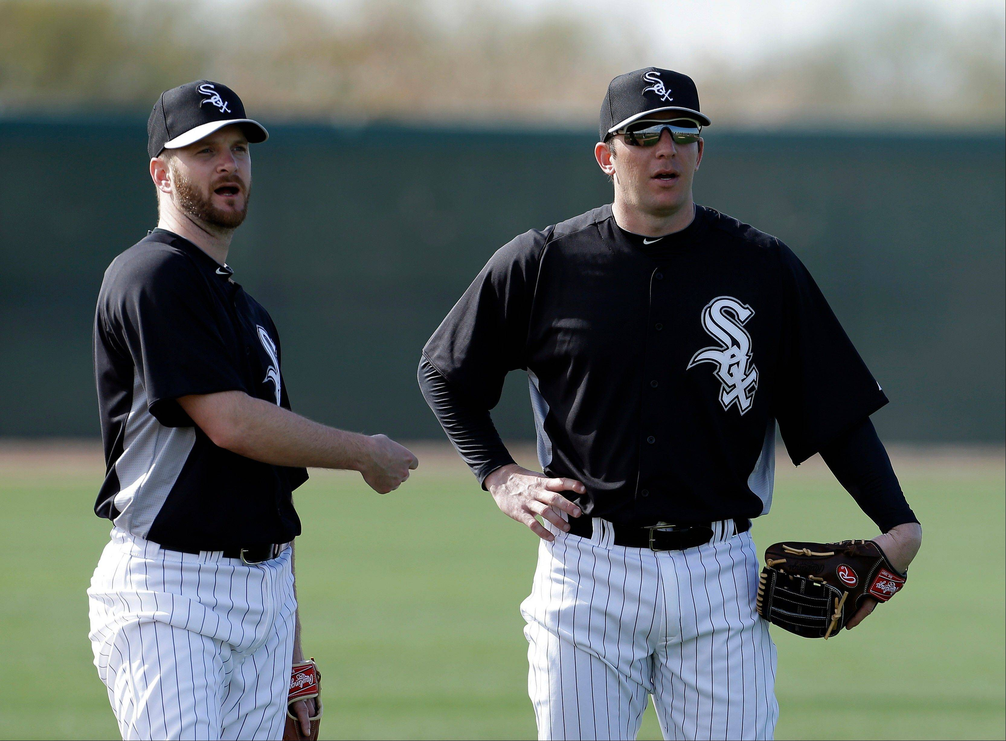 Chicago White Sox's Jeff Keppinger, left, talks with Brent Morel during a spring training baseball workout Tuesday, Feb. 19, 2013, in Phoenix.