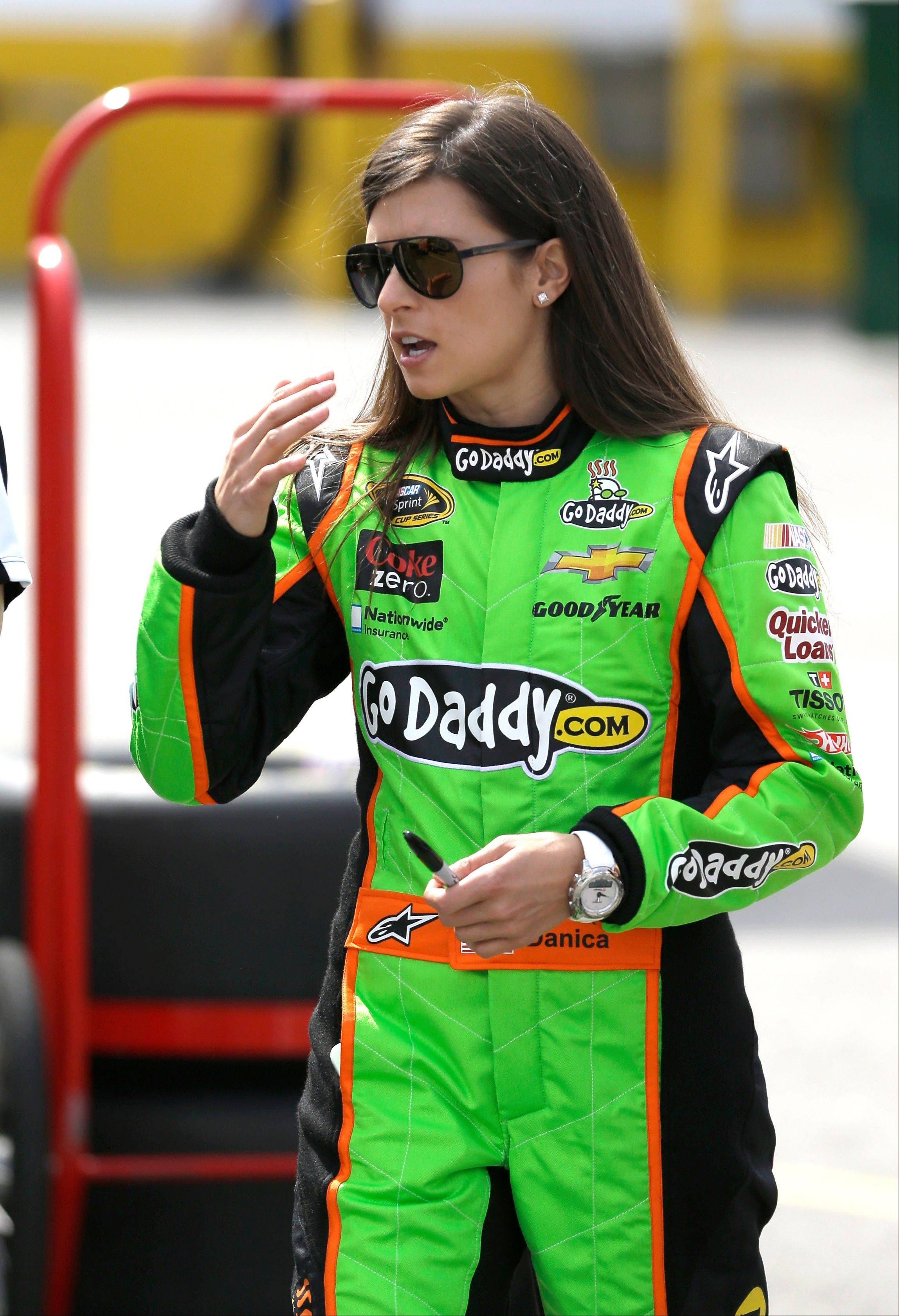 Danica Patrick walks to her hauler in the garage area during a practice session for the NASCAR Daytona 500 Sprint Cup Series auto race at Daytona International Speedway, Fr