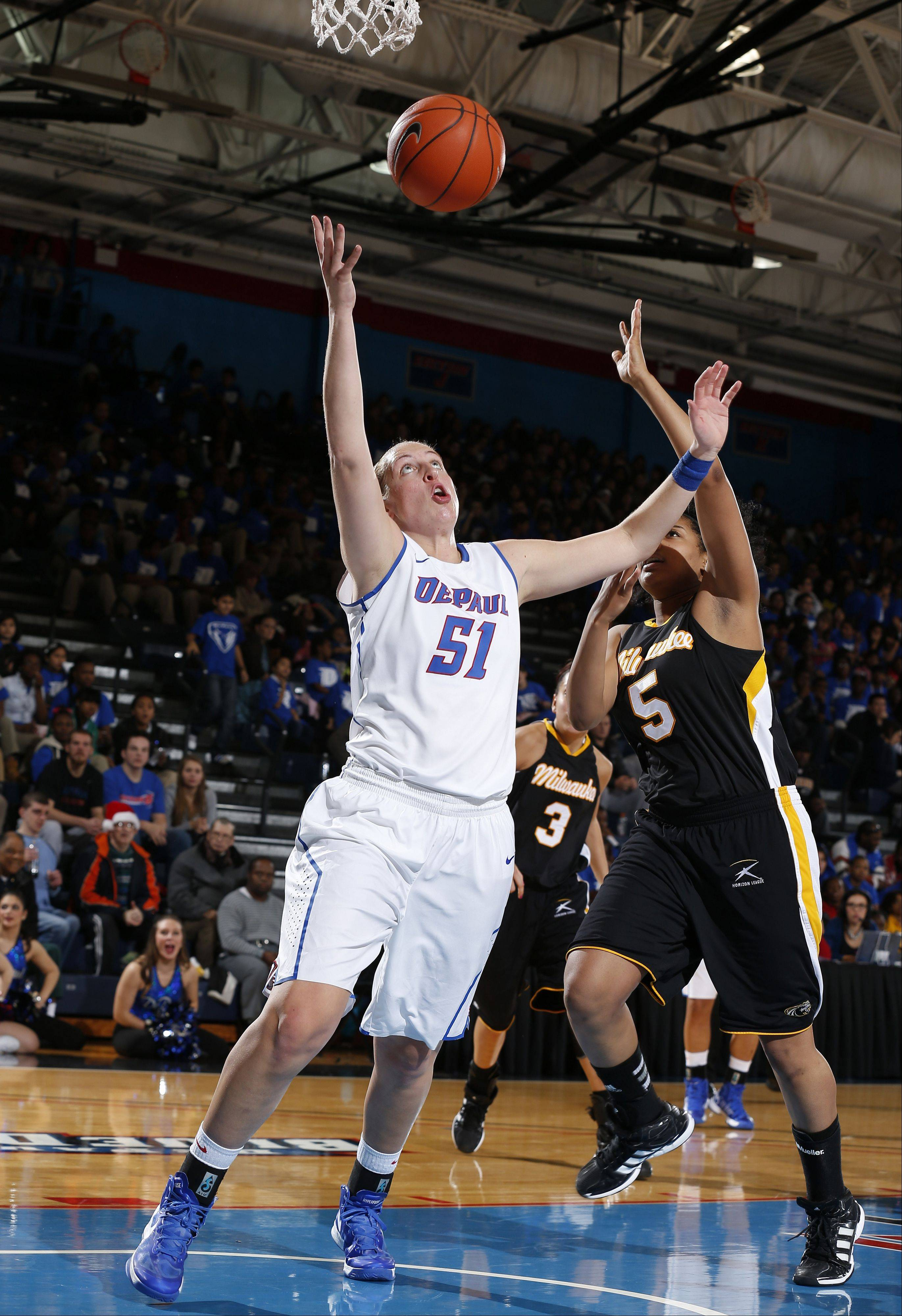 Katherine Harry of DePaul women's basketball team has recorded over 1,000 points and 1,000 rebounds in four years for the Blue Demons.