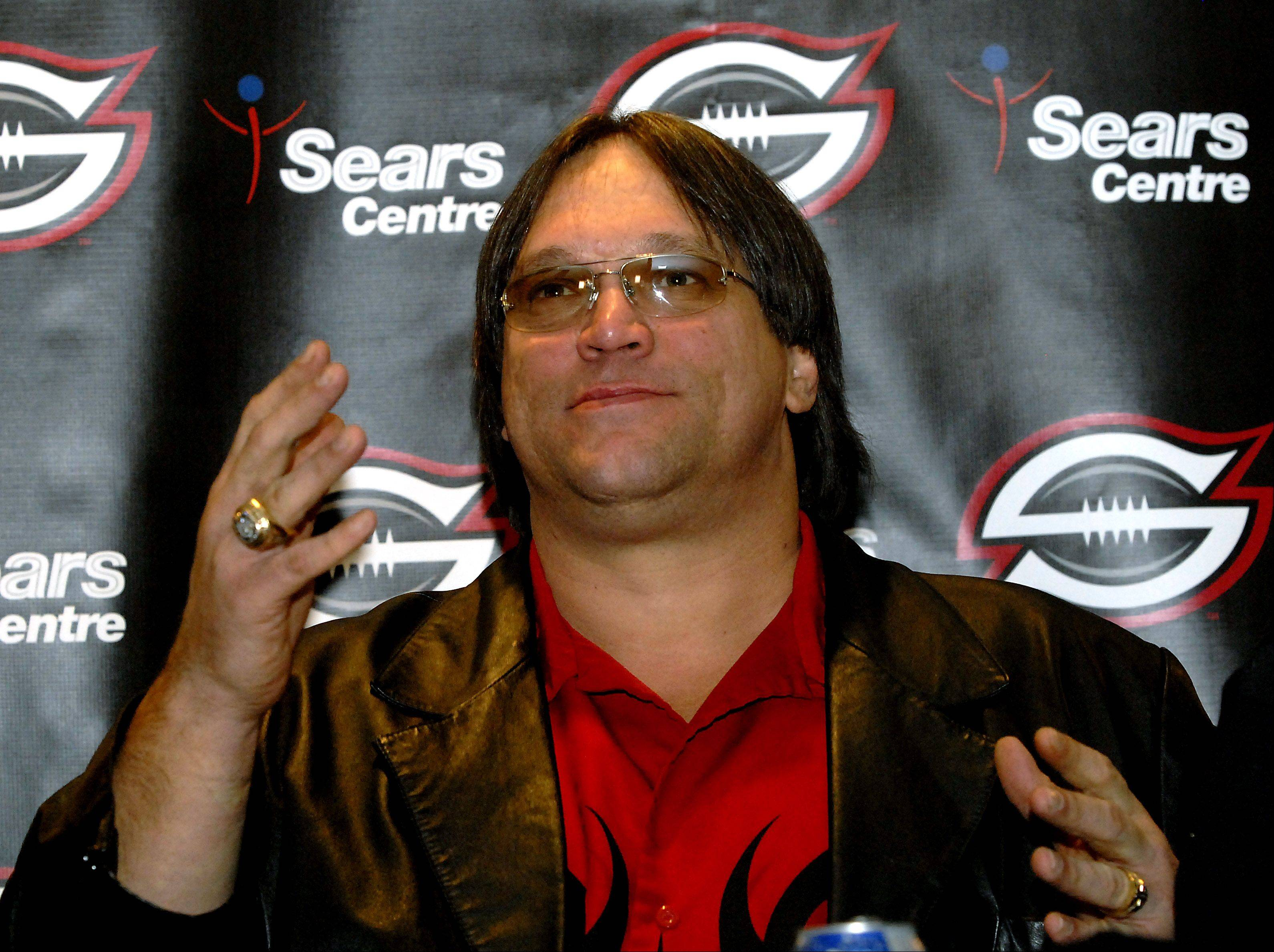 "HEfootball_1ne010907MW COOK Photo0573400 Mark Welsh Photos ///// News conference announcing the name, logo and coaching staff of the new Continental Indoor Football League team that will play at the Sears Centre in Hoffman Estates. It will be coached by former Chicago Bear lineman Steve ""Mongo"""
