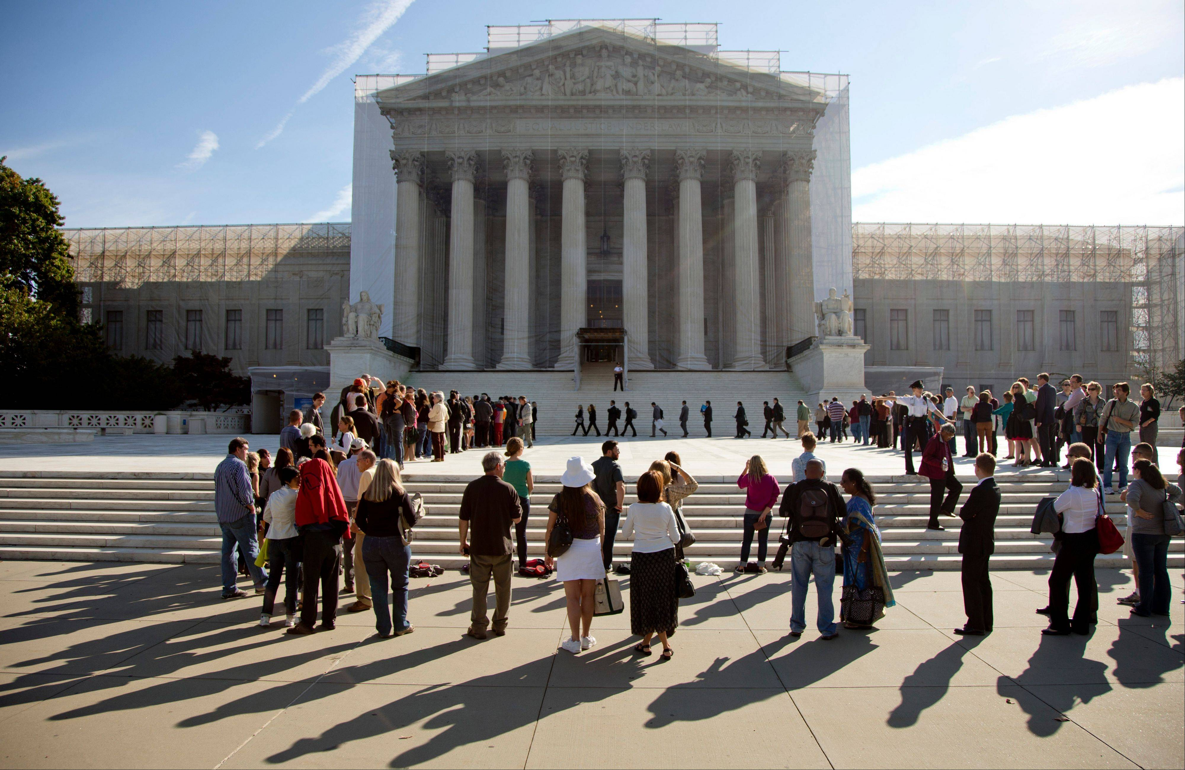 People wait in line to enter the Supreme Court in Washington last October as the court embarked on a new term.