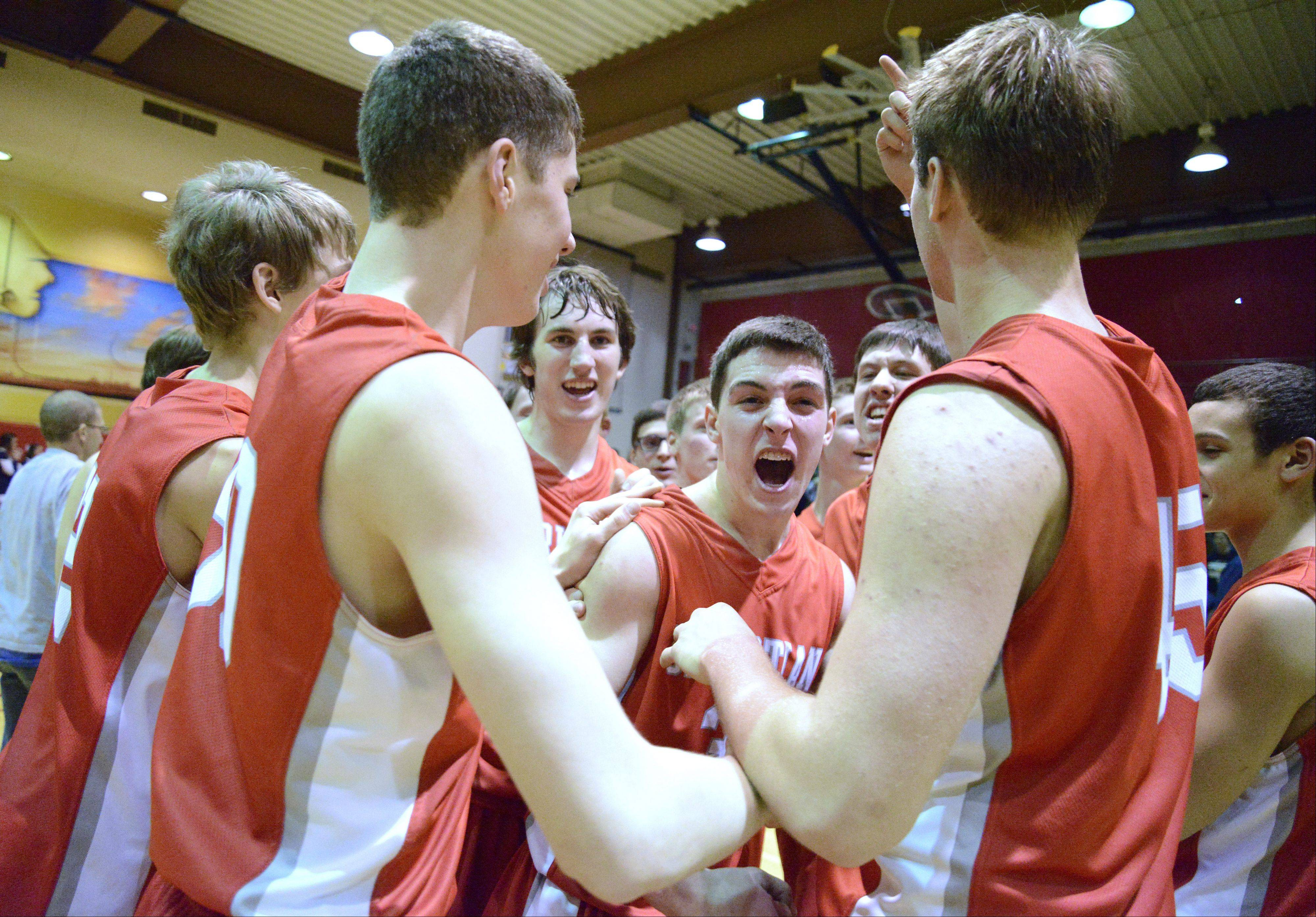 Aurora Christian's Ryan Suttle howls with excitement after the Eagles' win over Immaculate Conception.
