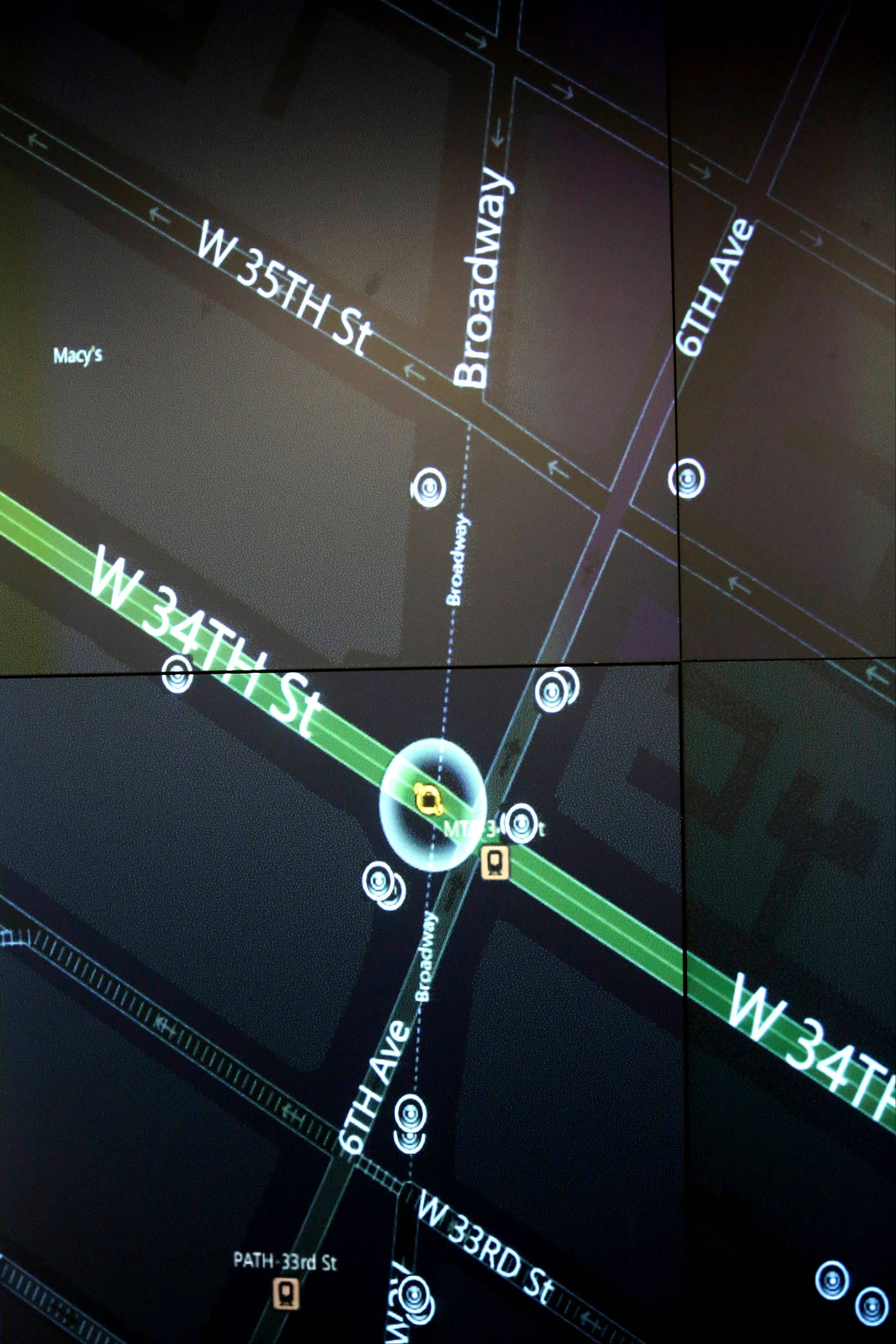 This Tuesday, Feb. 19, 2013 photo shows a detail of a video wall showing New York city police officers an interactive map of an area in the city, security footage from nearby cameras, if there are high radiation levels and whether any other threats have been made in New York.