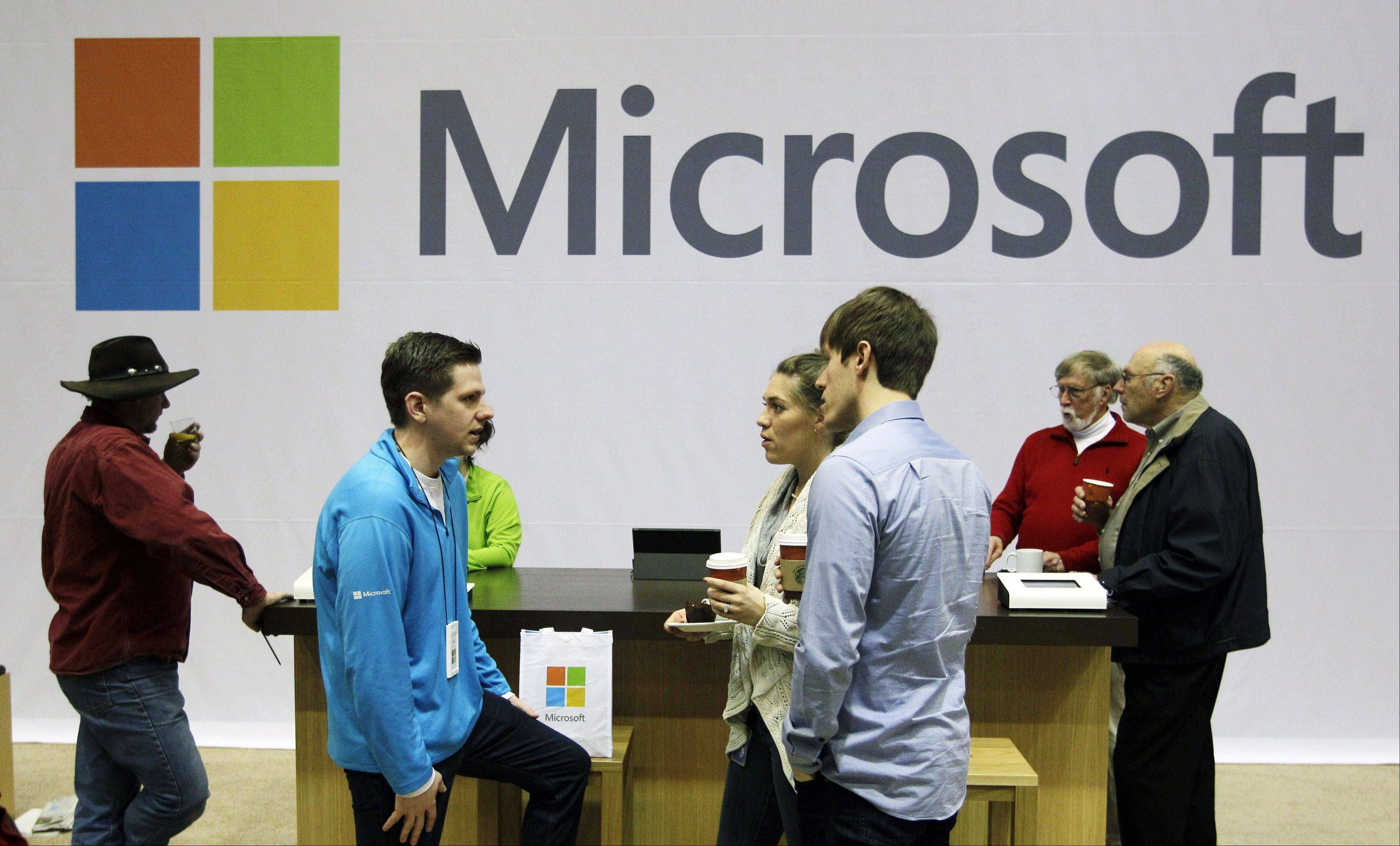 Microsoft Corp. retail store employees and guests mingle at a pop-up Microsoft Store during Microsoft's annual meeting of shareholders, in Bellevue, Wash. Longtime users of Hotmail, MSN and other Microsoft email services will start noticing a big change: When they sign in to check messages, they'll be sent to a new service called Outlook.com.