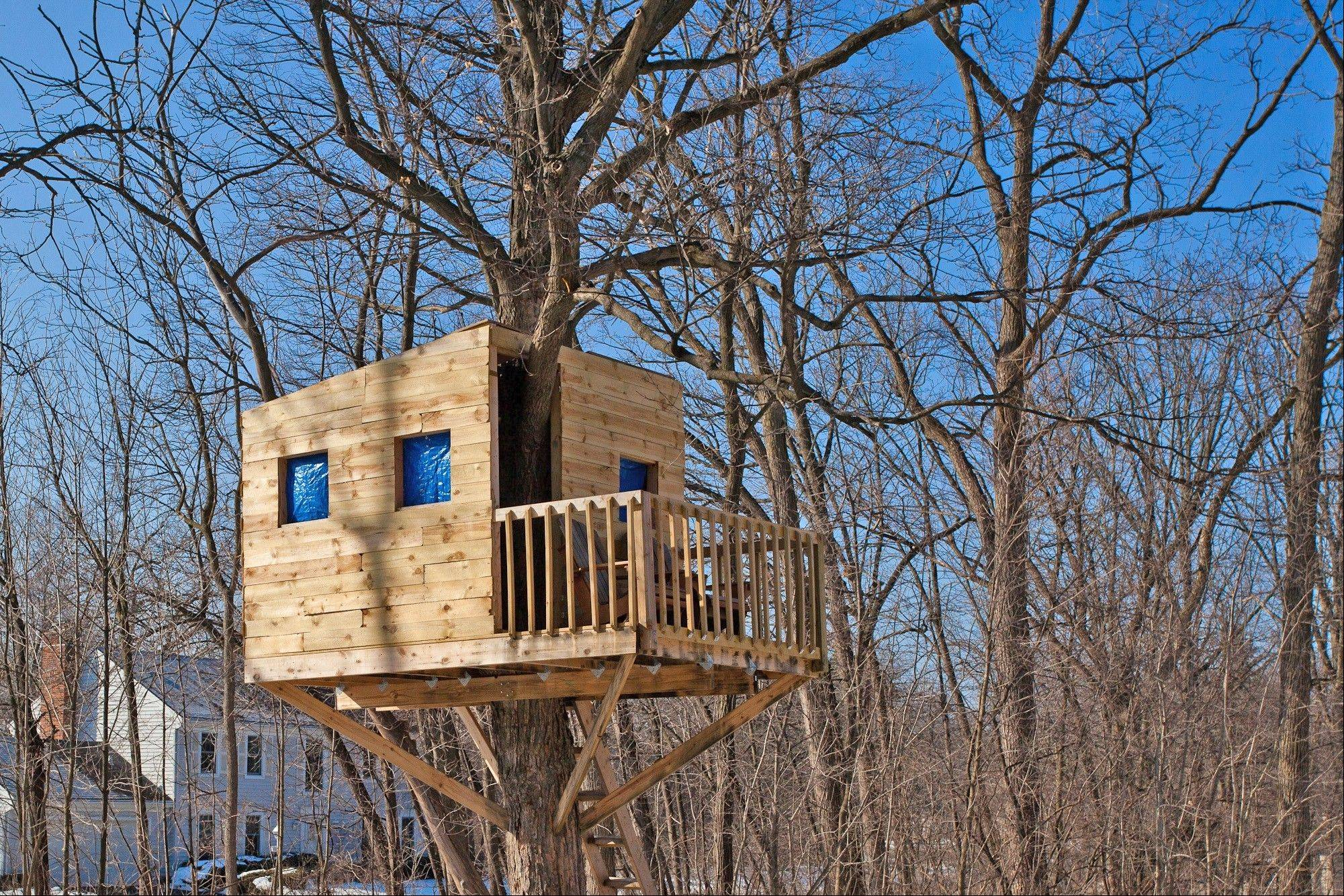 A new treehouse out back was built in one of more than 20 mature trees on the property.