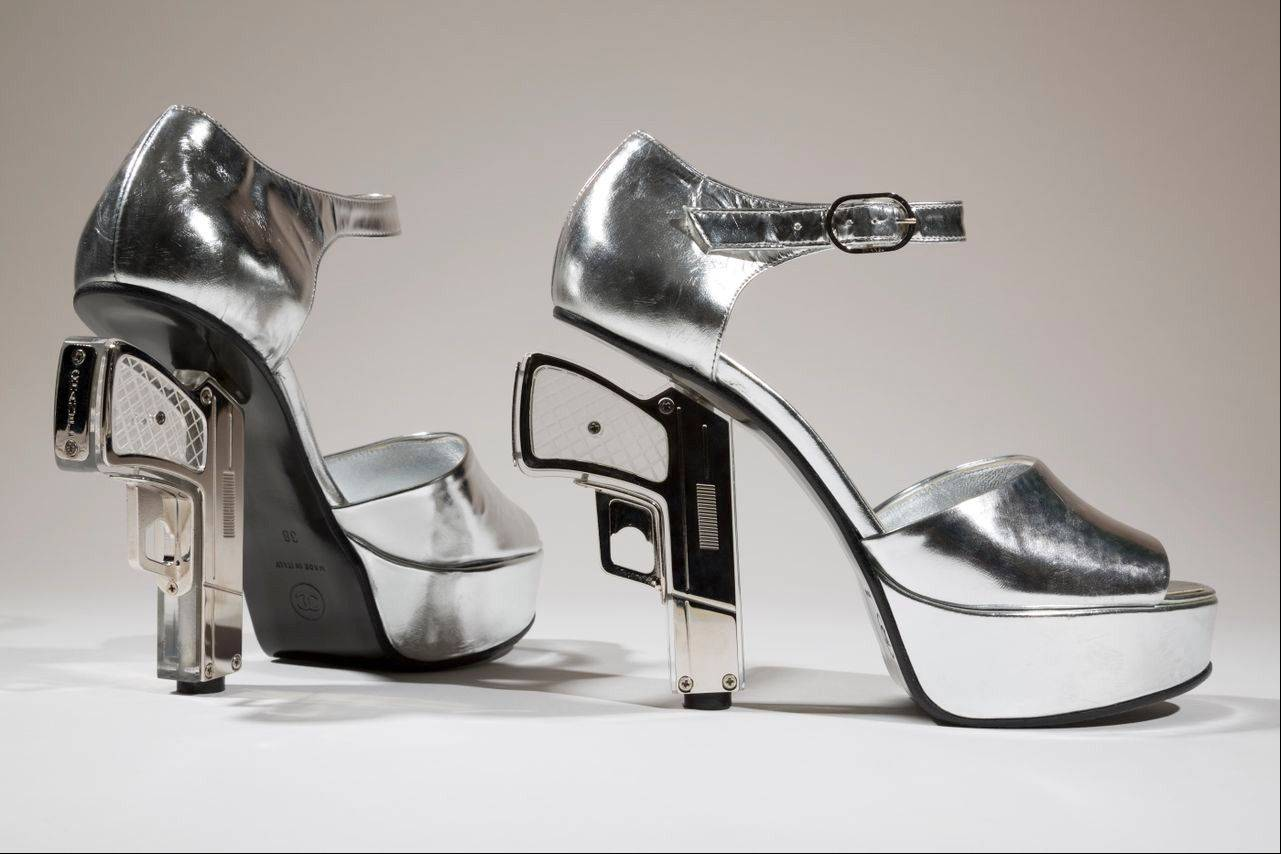 "Silver shoes designed by Chanel with guns as heels. The shoe is on display at the ""Shoe Obsession"" exhibit at The Museum at the Fashion Institute of Technology Museum in New York."