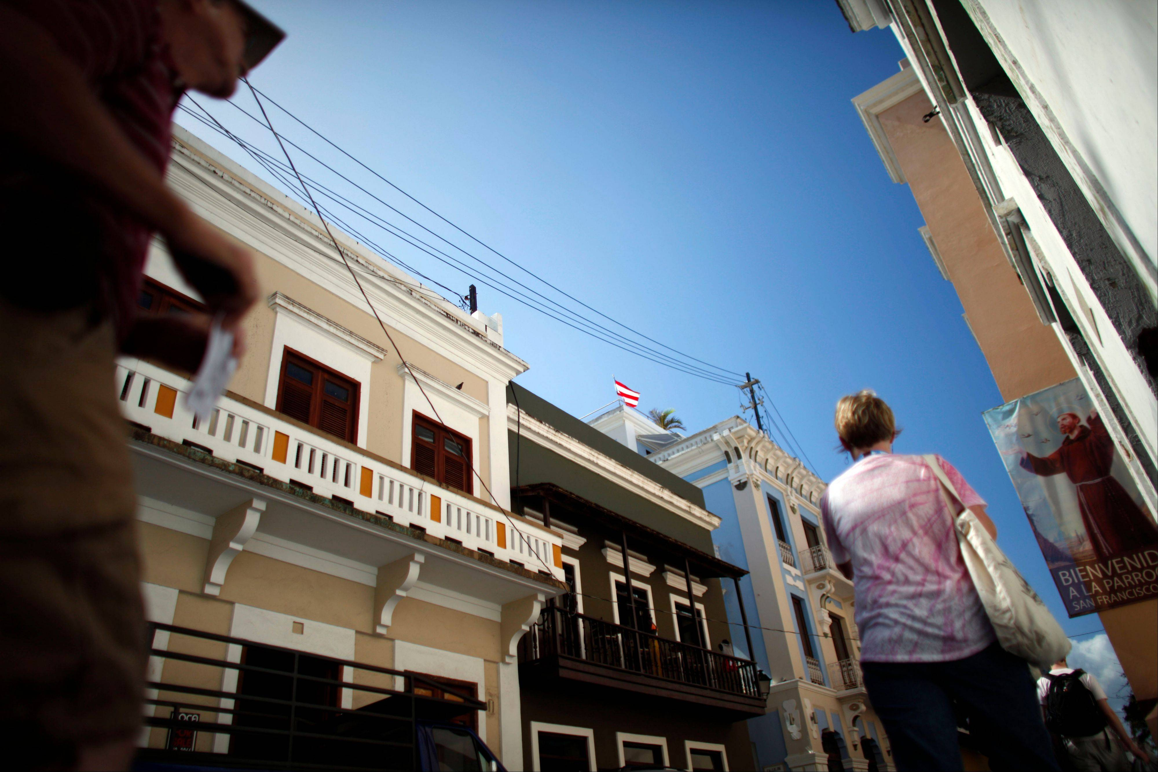 People walk in a street of the historic colonial section of San Juan named Old San Juan in Puerto Rico.