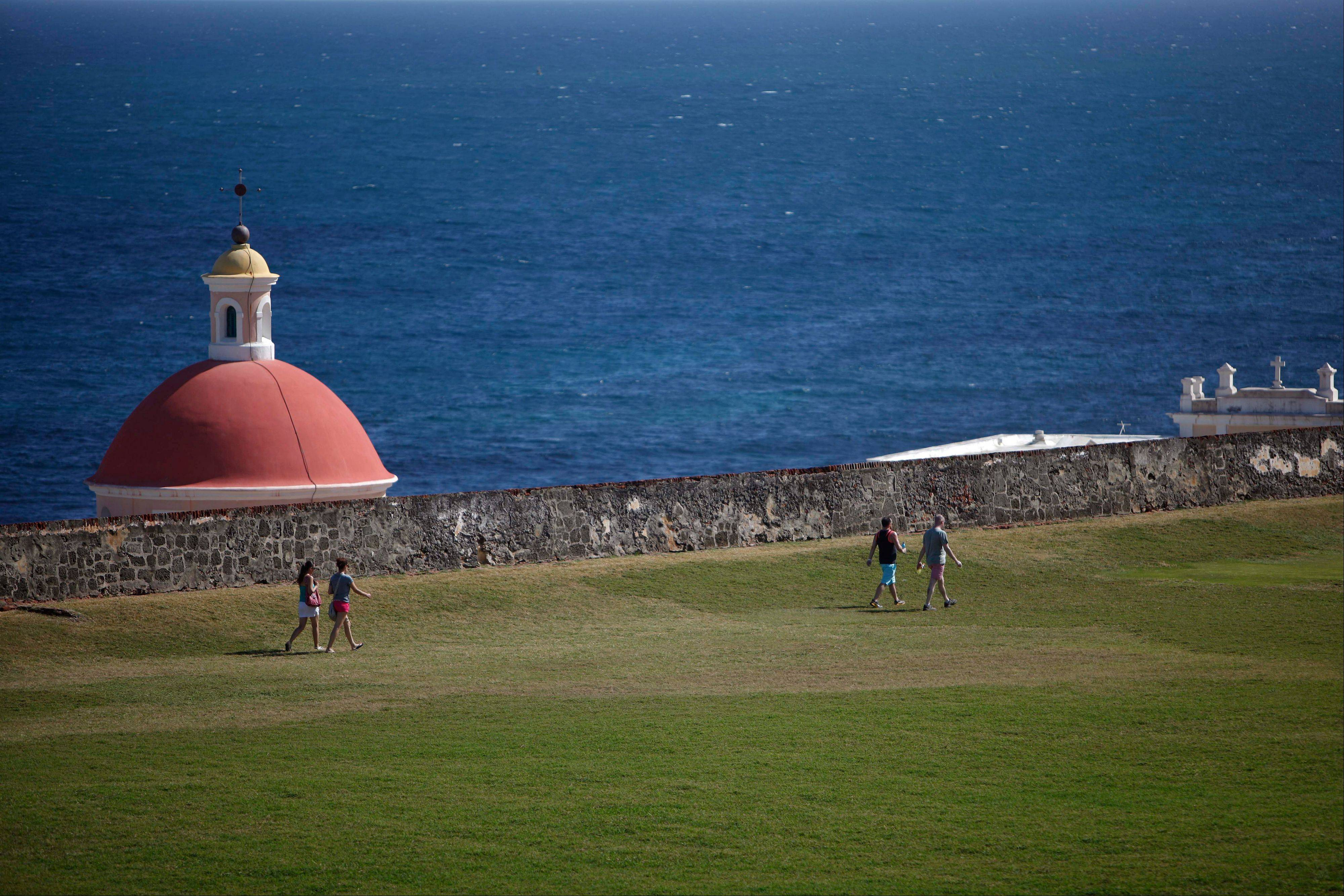 Tourists visit the 16th-century Spanish fort called El Morro in Old San Juan. There's an entrance fee to enter the Castillo San Felipe del Morro, but the best way to enjoy this U.S. National Historic Site requires no money at all.