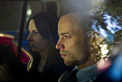 Olympic athlete Oscar Pistorius, right, and his sister Aimee, left, are driven to a relatives home in Pretoria, South Africa, Friday, Feb. 22, 2013. Pistorius was released on bail and will return to court June, 4, 2013 to face charge a charge of pre-meditated murder in the shooting death of his girlfriend, Reeva Steenkamp.