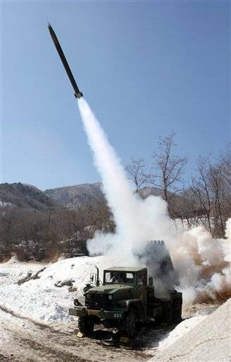 South Korean Army's multiple rocket launcher fires live rounds during an exercise at Fire Training Field in Cheorwon, South Korea, Friday, Feb. 15, 2013. North Korea is upgrading one of its two major missile launch sites, apparently to handle much bigger rockets, and some design features suggest it is getting help from Iran, a U.S. research institute said Thursday.