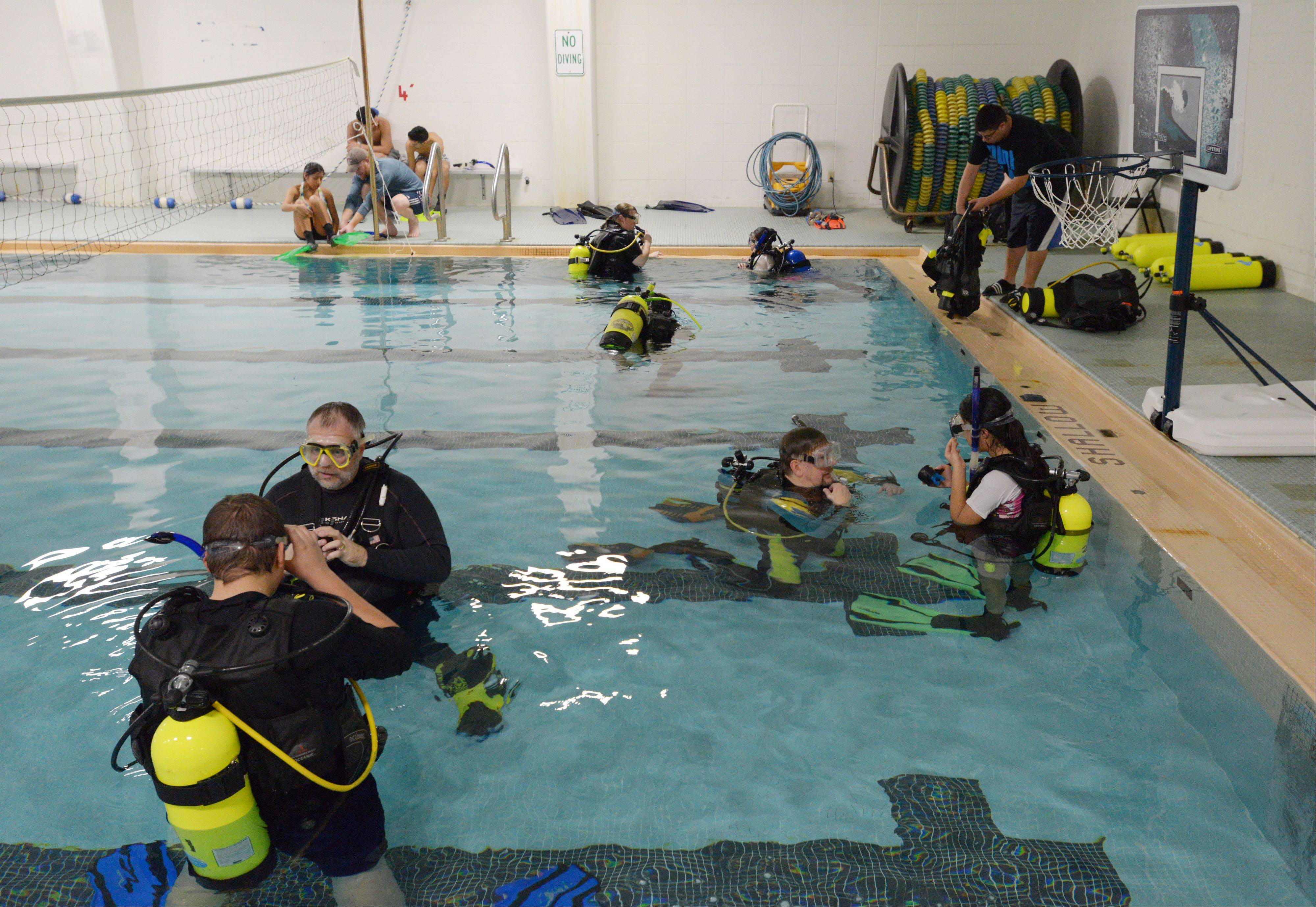 Aurora teens involved with Triple Threat Mentoring take a scuba lesson Saturday in the East Aurora High School pool from volunteer instructors with S.T.A.R.S. International, a scuba instruction nonprofit.