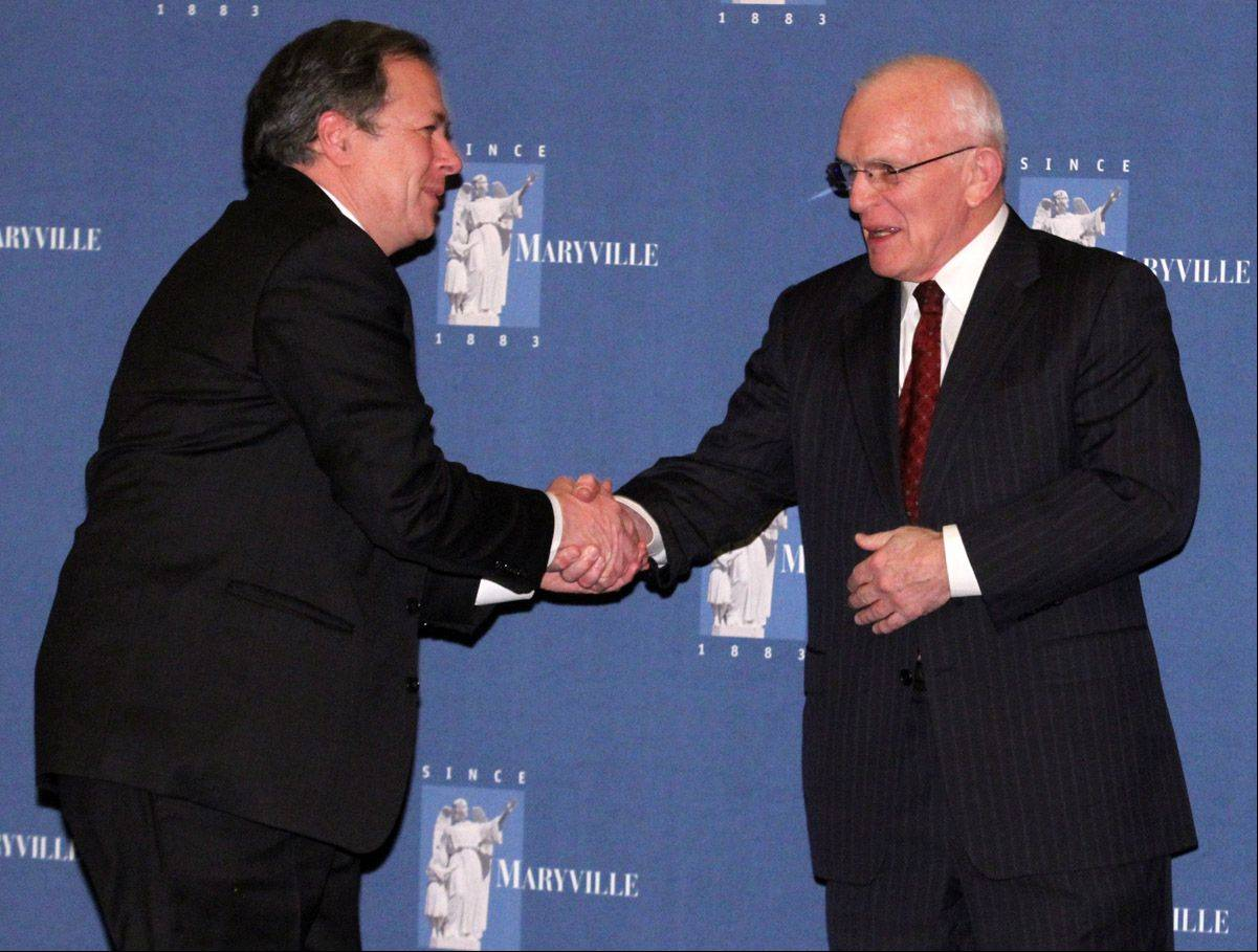 Daily Herald columnist Burt Constable receives a handshake from Richard Devine, chairman of the Maryville board of directors, before Constable received the Spirit of Maryville Award during Maryville Academy's 2013 Guardian Medallion Award Gala on Saturday night at the JW Marriott in Chicago