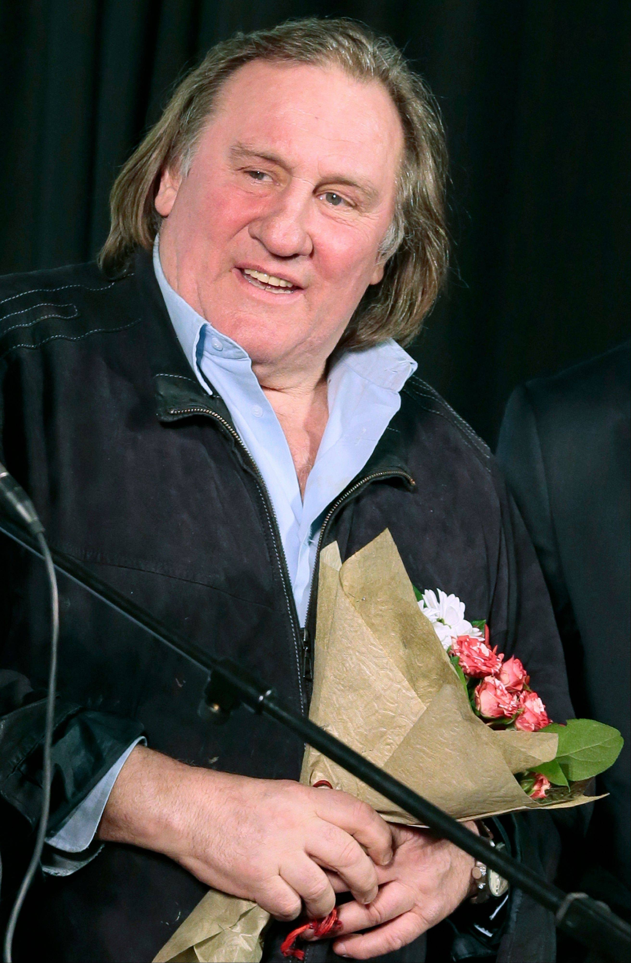 French actor Gerard Depardieu speaks Friday at the opening ceremony of the Illusion movie theater after its restoration in Moscow. President Vladimir Putin granted Depardieu Russian citizenship last month and Saturday he registered as a permanent resident of the city of Saransk.