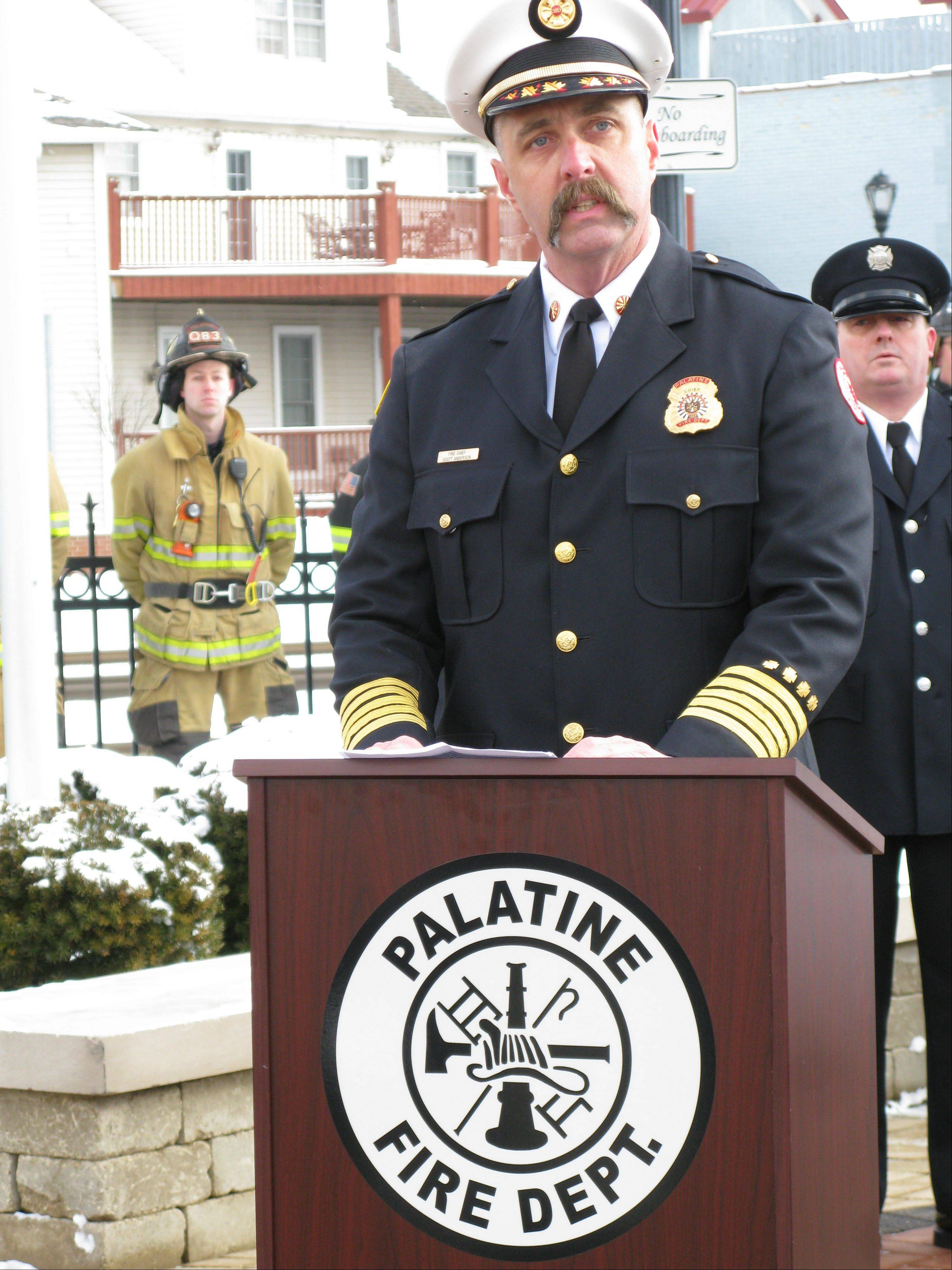 Palatine Fire Chief Scott Andersen talks about the ultimate sacrifice given by three fallen volunteer firefighters, John Wilson, Richard Freeman and Warren Ahlgrim, who perished during a fire rescue on Feb. 23, 1973. Roughly 200 people, including firefighters from several suburban departments, attended a ceremony Saturday at the Firefighters Memorial in downtown Palatine to honor their memory and commemorate the 40th anniversary of their deaths.