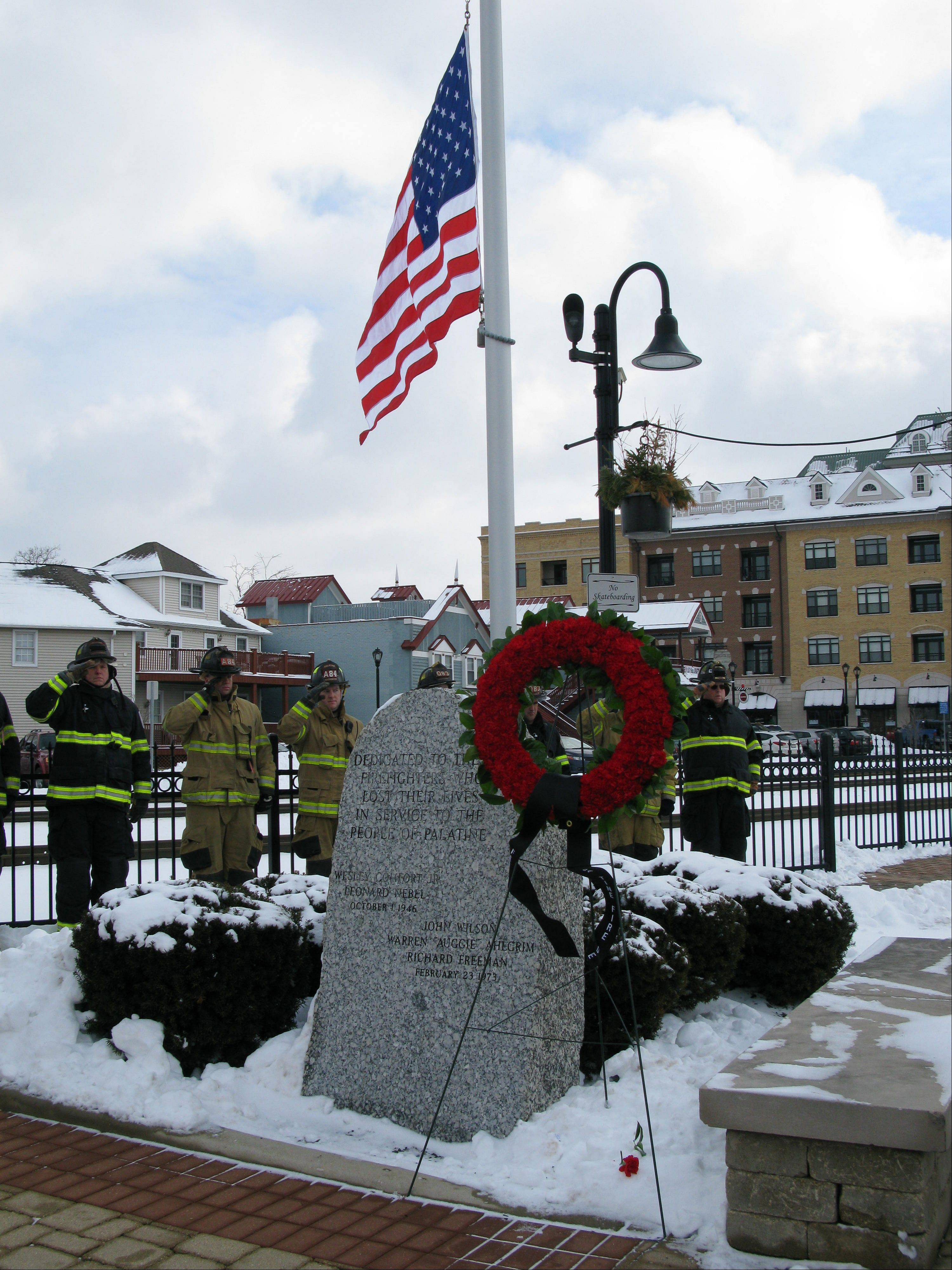 A wreath was placed Saturday on the memorial for three fallen volunteer Palatine firefighters, John Wilson, Richard Freeman and Warren Ahlgrim, who perished during a fire rescue on Feb. 23, 1973. Roughly 200 people, including firefighters from area departments, attended a ceremony honoring their memory and commemorating the 40th anniversary of their deaths at the Palatine Firefighters Memorial.