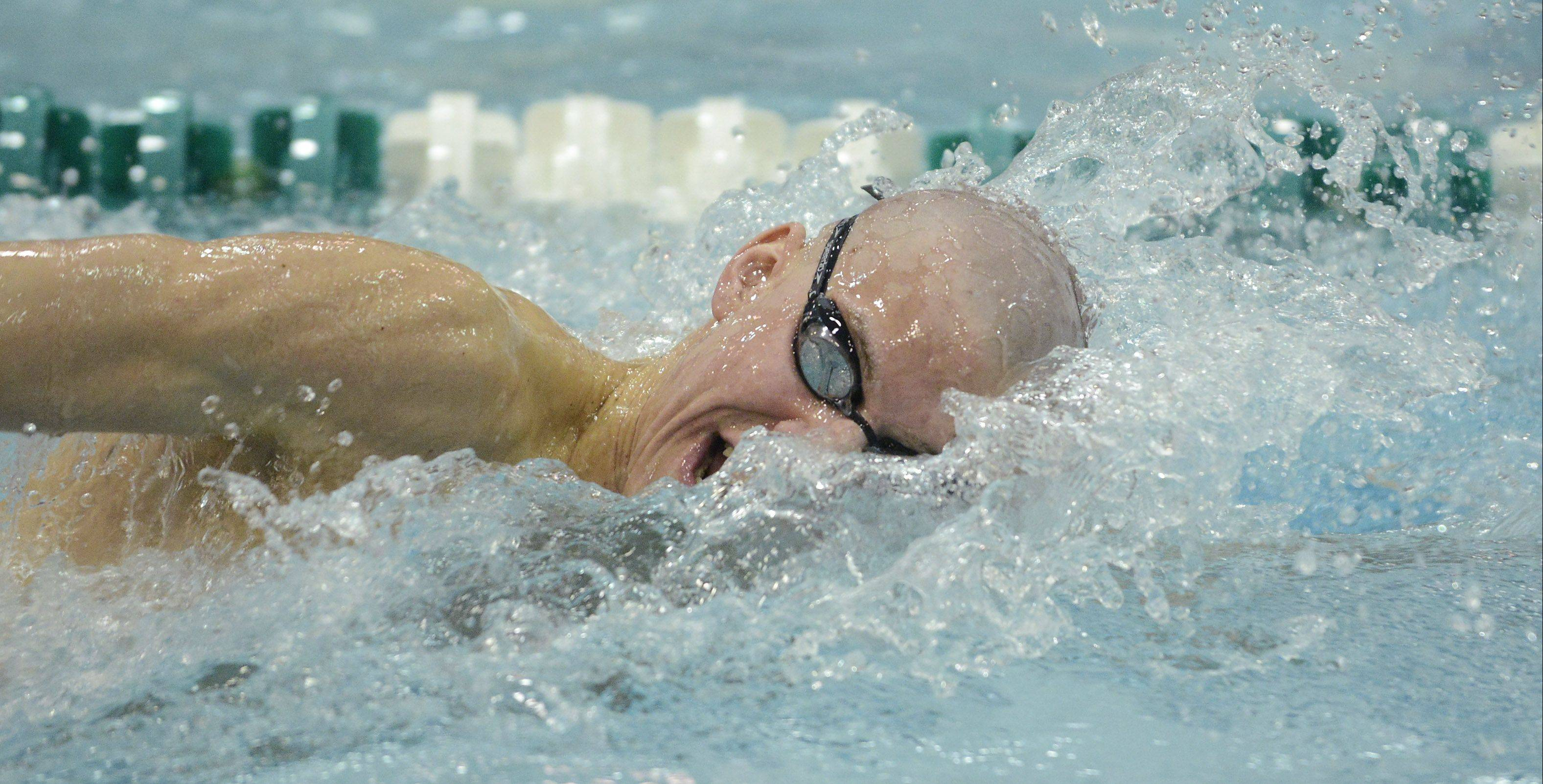 St. Charles North's Kyle Gannon swims to a fifth-place finish in the 500-yard freestyle during the boys state swimming finals at New Trier High School in Winnetka Saturday.