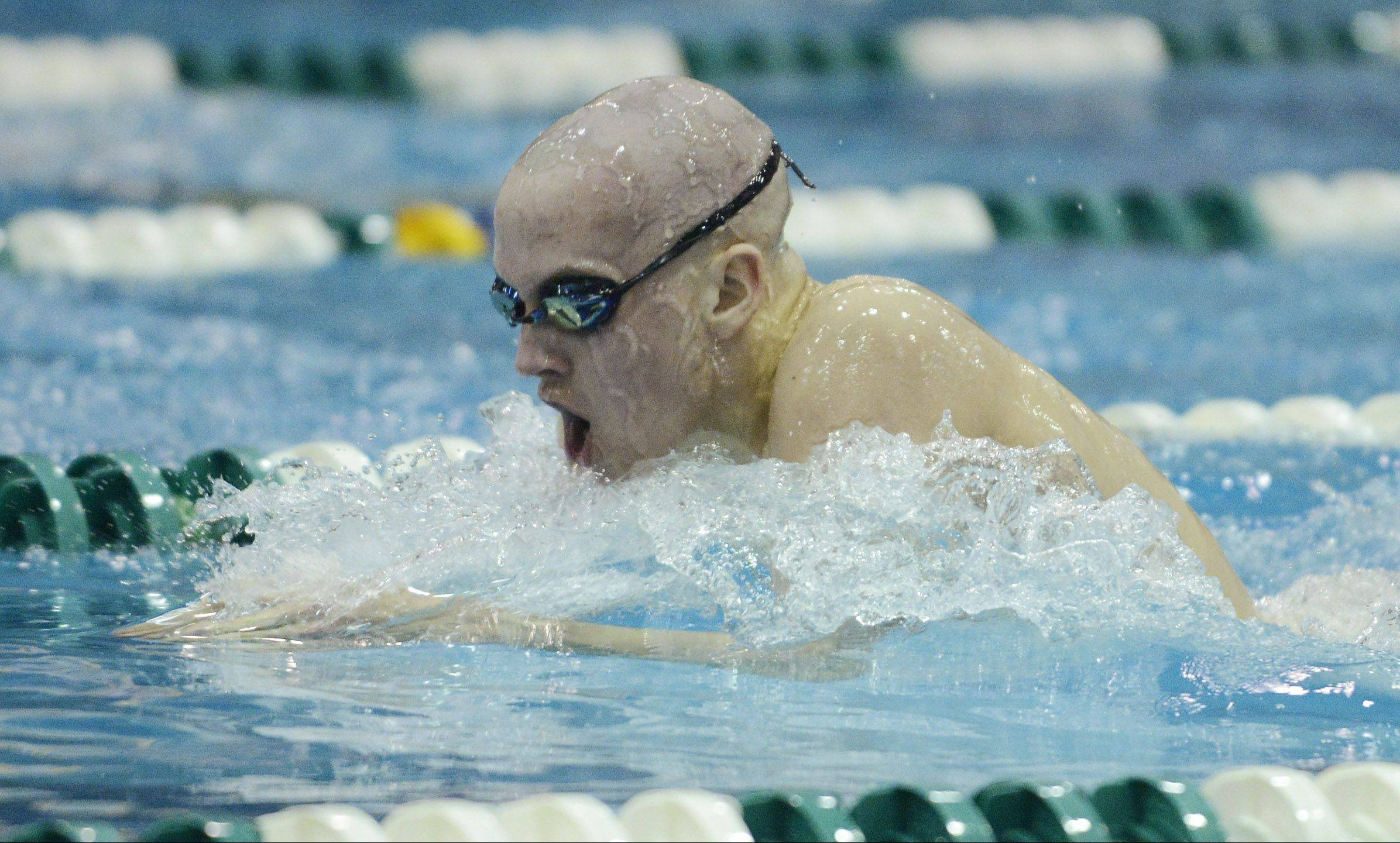 Will Shanel of St. Charles East swims the breaststroke in the 200-yard individual medley Saturday.