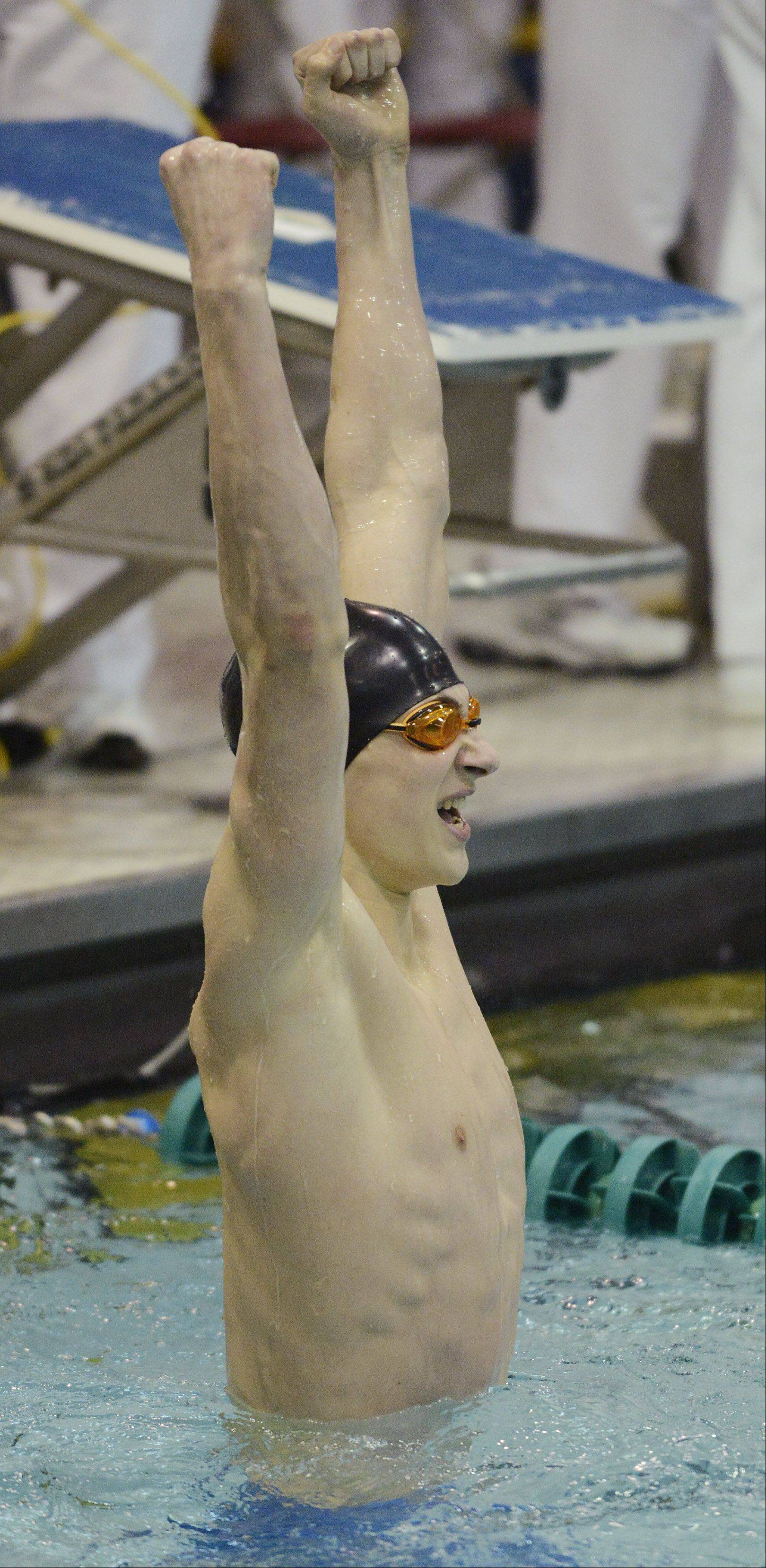 Mundelein's Connor Black celebrates after setting a national record in the 100-yard butterfly of 46.71 in the boys swimming state finals at New Trier High School in Winnetka on Saturday.