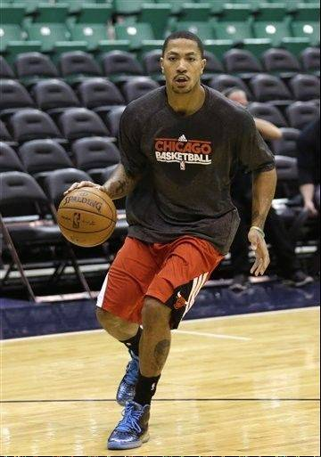 Chicago Bulls' Derrick Rose works out before the Bulls' NBA basketball game against the Utah Jazz on Friday, Feb. 8, 2013, in Salt Lake City.