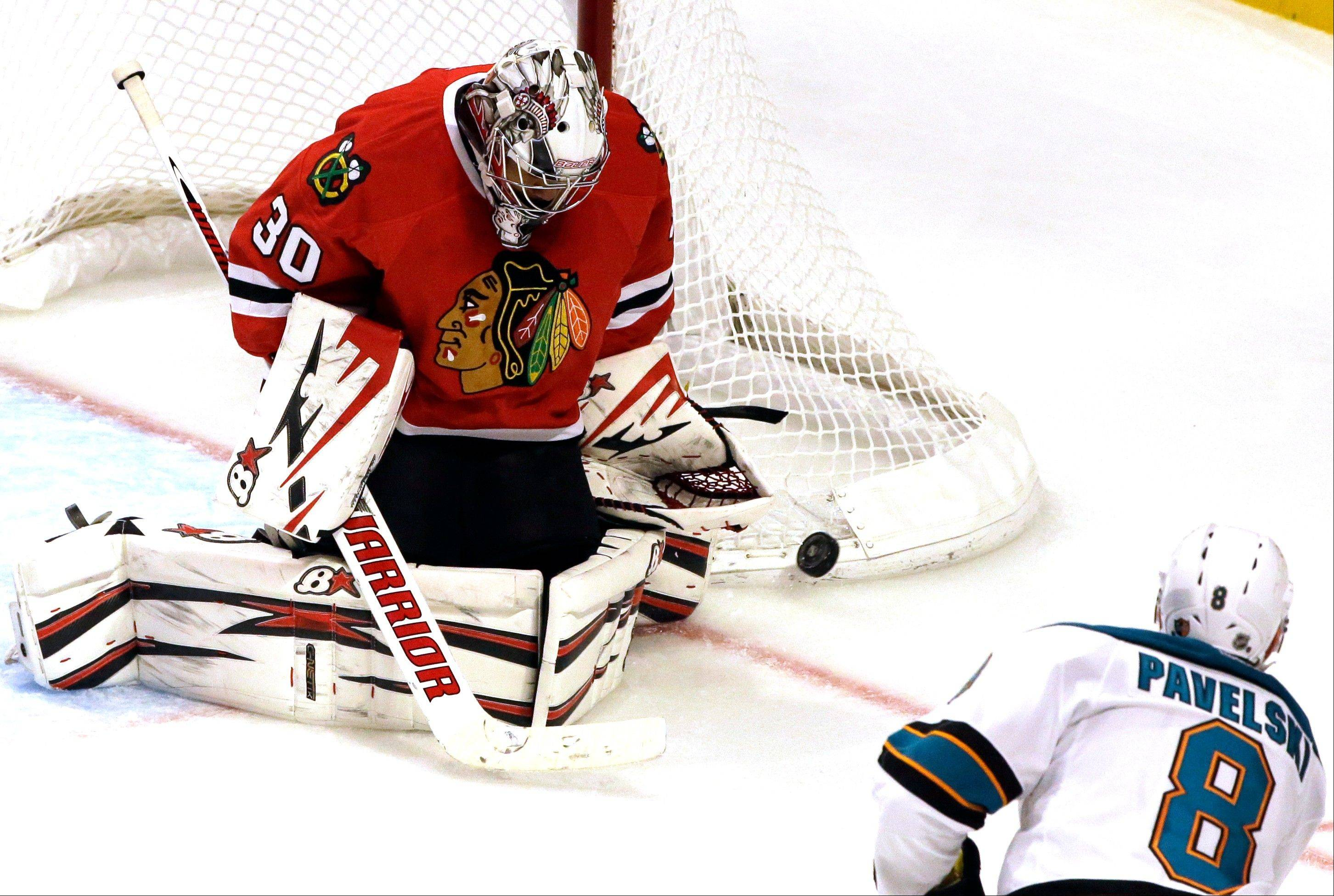 Chicago Blackhawks goalie Ray Emery (30) blocks a shot by San Jose Sharks' Joe Pavelski (8) during the third period of an NHL hockey game in Chicago, Friday, Feb. 22, 2013. The Blackhawks won 2-1.