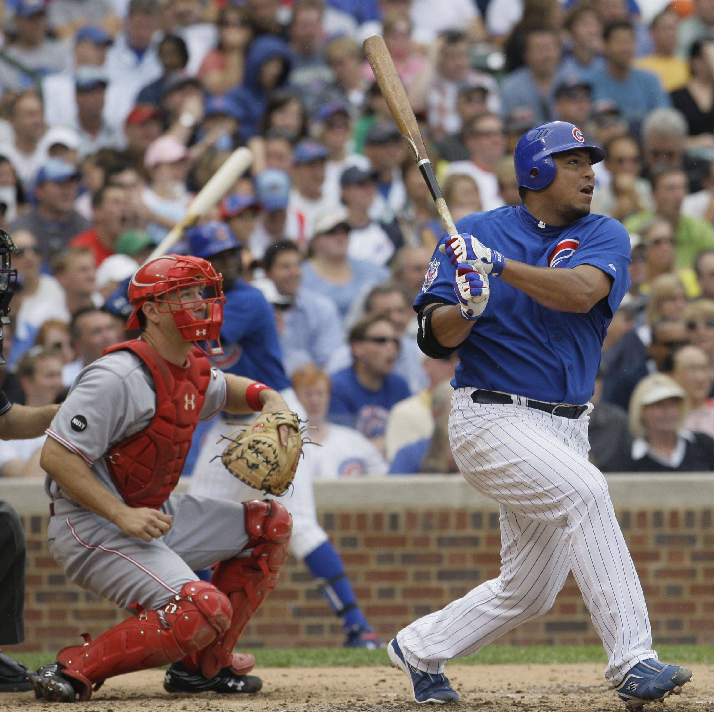 Chicago Cubs' Carlos Zambrano and Cincinnati Reds catcher Paul Bako watch Zambrano's solo home run during the third inning of a baseball game Thursday, Aug. 21, 2008, in Chicago.