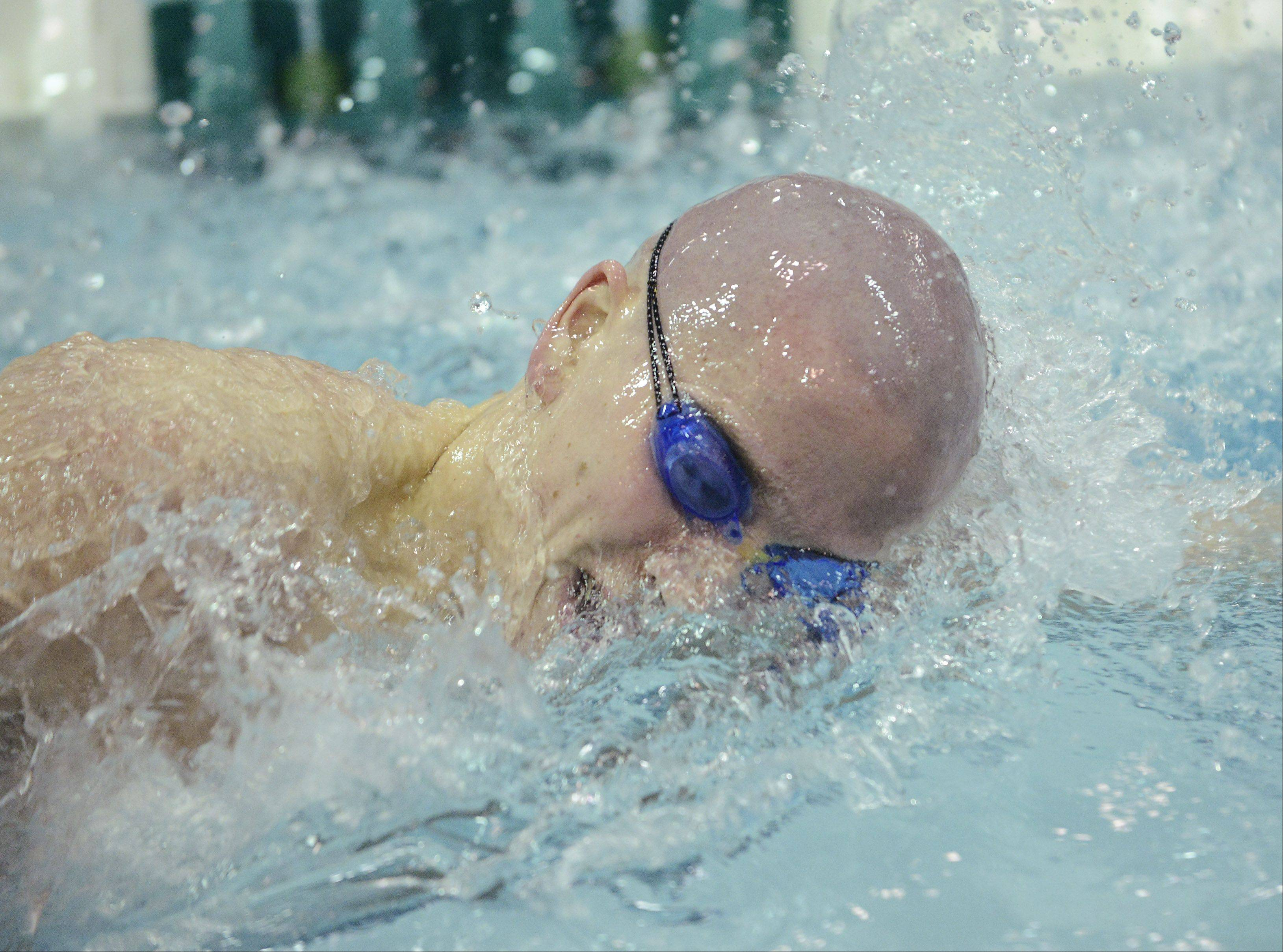 Conant's Jonathon Burke swims to a third-place finish in the 500-yard freestyle during the boys state swimming finals at New Trier High School in Winnetka Saturday.