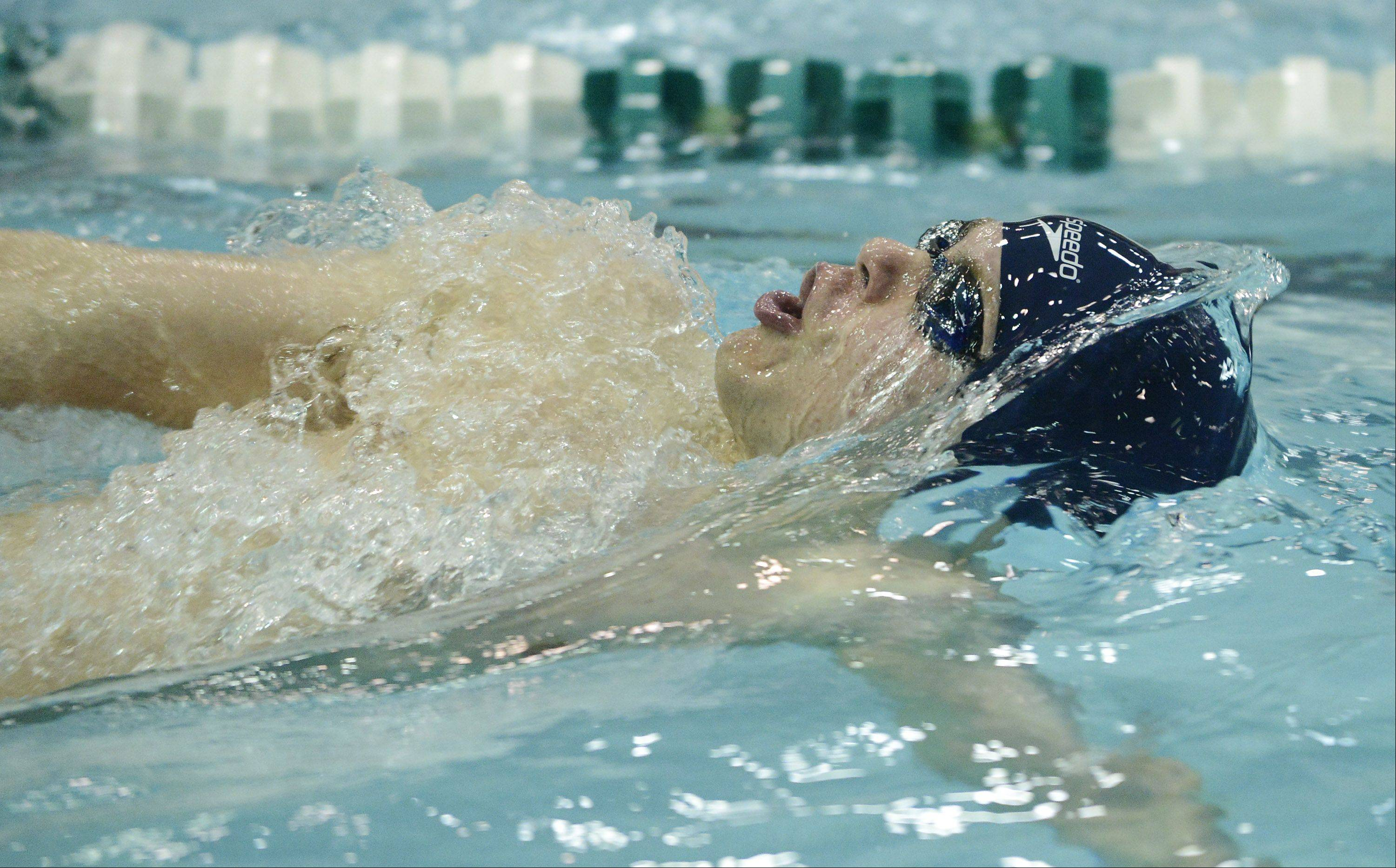 Michael Hamann of Cary-Grove swims backstroke in the 200-yard individual medley during the boys state swimming finals at New Trier High School in Winnetka Saturday.