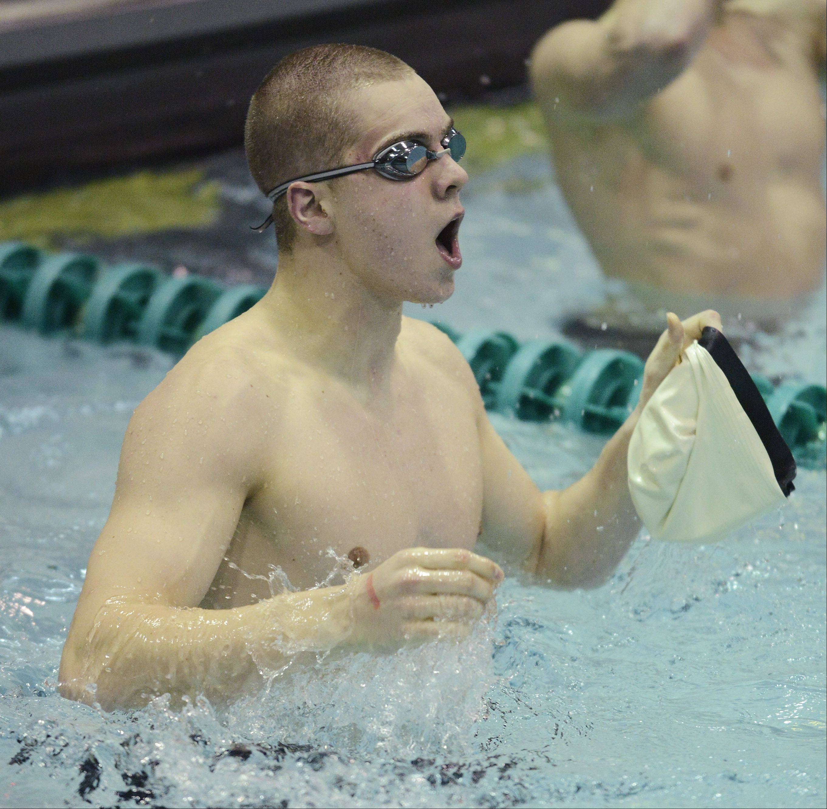 Adam Stacklin of Waubonsie Valley reacts to his second-place finish in the 100-yard freestyle during the boys state swimming finals at New Trier High School in Winnetka Saturday.